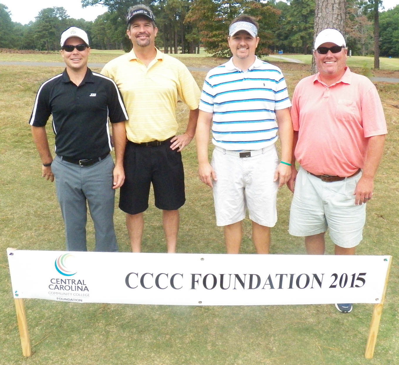 Click to enlarge,  The team of Andy Phillips, Wayne Freeman Jr., Tripp Brizendine, and Mike Cox tied for first in the first flight of the afternoon tournament of the CCCC Foundation Lee Golf Classic.
