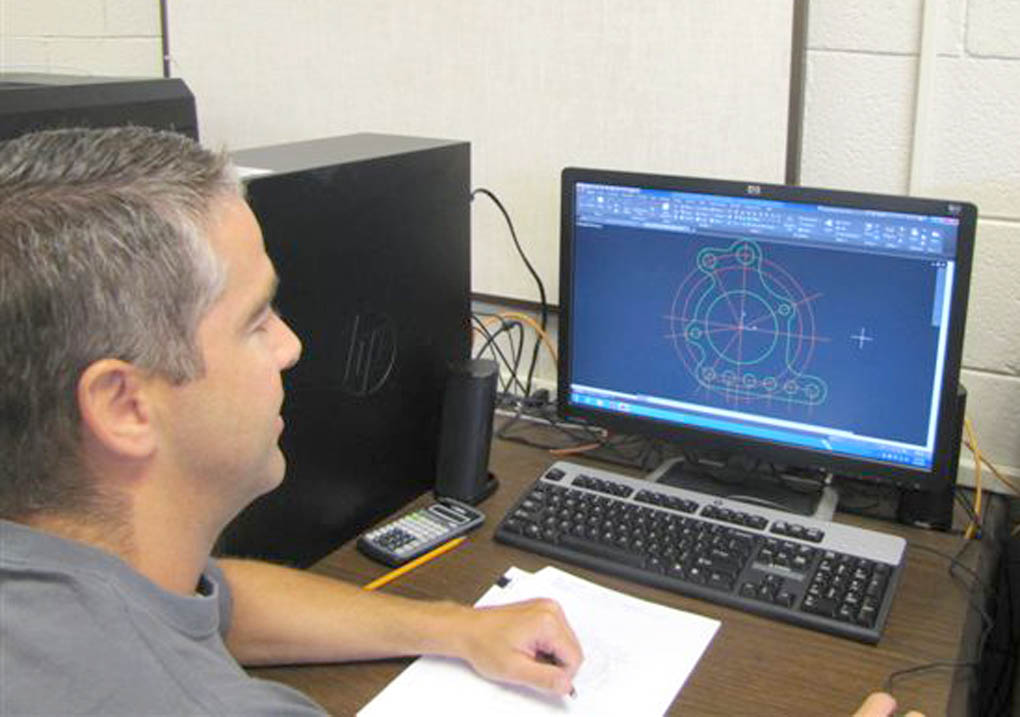 Click to enlarge,  Wes Sugg, a student enrolled in CCCC's CAD program, works on a drafting design in the computer lab.
