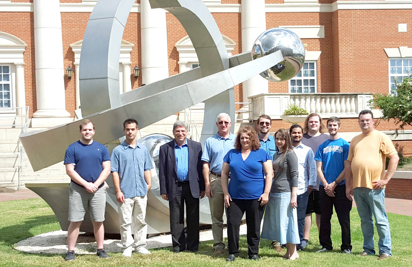 Click to enlarge,  Touring the Center for Optoelectronics and Optical Communications on the University of North Carolina at Charlotte's campus were, left to right: Jeremiah Roberts, Thomas Martin, Dr. Chrys Panayiotou, Gary Beasley, Katie Hall, David Pope, Angela Humphries, Nishal Patel, Joshua Roberts, Nathanael Turley, and Scott Williams.