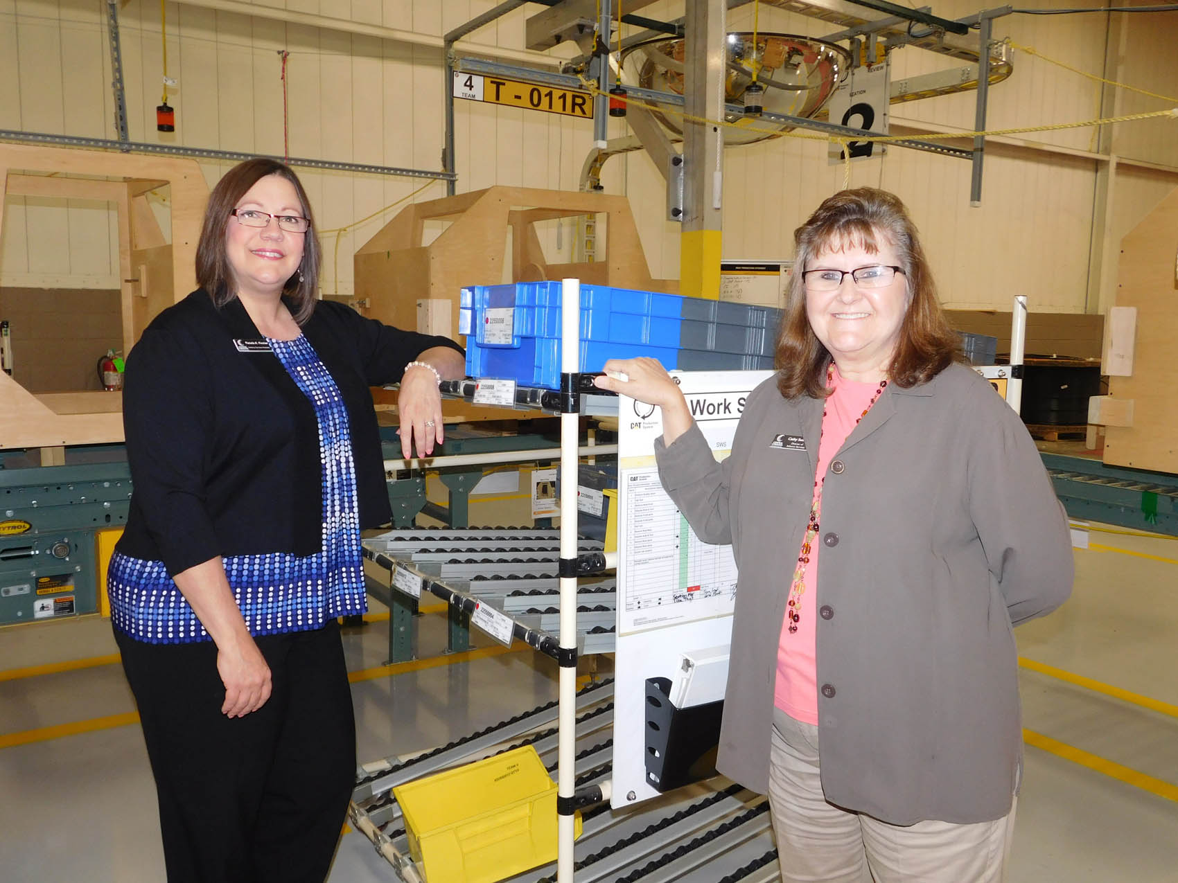Click to enlarge,  Pamela Fincher (left) and Cathy Swindell, of the Central Carolina Community College Innovation Center, look forward to hosting 2015 Manufacturing Day festivities.
