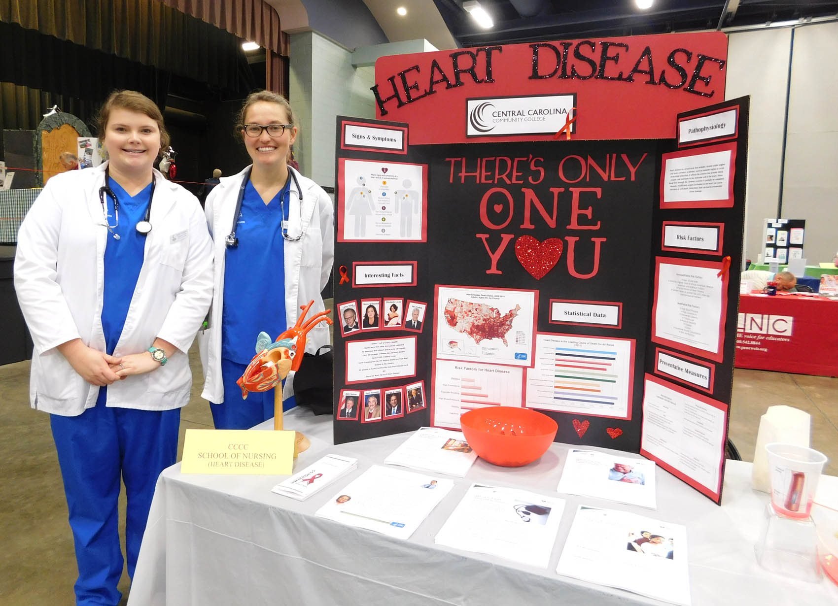 Click to enlarge,  Central Carolina Community College School of Nursing students Emily Turlington and Sophie Schlegel were pictured during the Lee County Schools/CCCC Family Health & Benefits Fair on Tuesday, Nov. 3, at the Dennis A. Wicker Civic Center.
