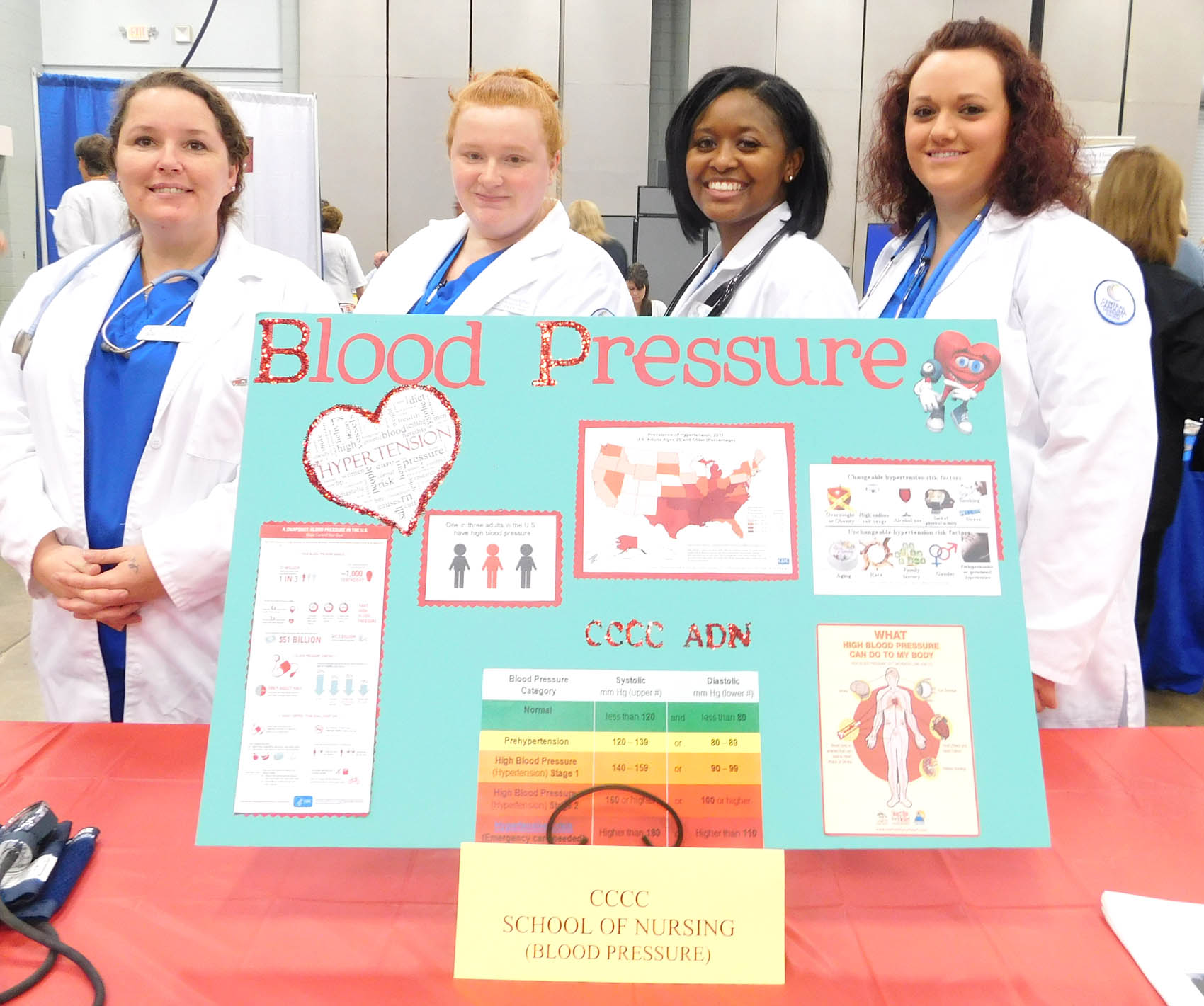 Click to enlarge,  Central Carolina Community College School of Nursing students Michelle Jones, Jessica Pomey, Sakeshia Hayes, and Courtney Johnson were pictured during the Lee County Schools/CCCC Family Health & Benefits Fair on Tuesday, Nov. 3, at the Dennis A. Wicker Civic Center.