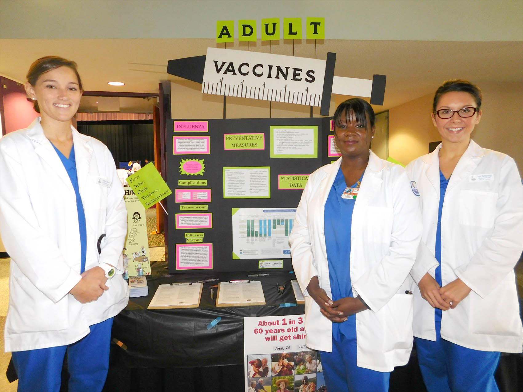 Click to enlarge,  Central Carolina Community College School of Nursing students Abbigail Hauser, Michelle Durham, and Paige Yarborough were pictured during the Lee County Schools/CCCC Family Health & Benefits Fair on Tuesday, Nov. 3, at the Dennis A. Wicker Civic Center.