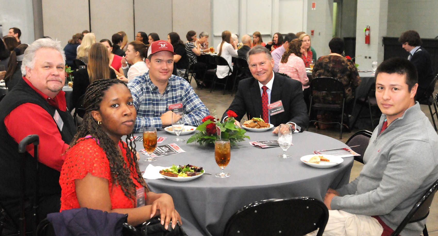 Click to enlarge,  Former North Carolina Lt. Gov. Dennis Wicker (second from right) visits with students and faculty during the CCCC Foundation Scholarship Luncheon. Others pictured are (left to right) Shana Jackson, recipient of the Exchange Club of Sanford Scholarship; CCCC Industrial Systems Technology Chair Allen Howington; Justin Phillips, recipient of the J. Shelton and Clarice B. Wicker Scholarship; Mr. Wicker; and Richard Glitz, recipient of the J. Shelton and Clarice B. Wicker Scholarship.