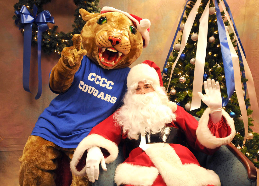Click to enlarge,  Central Carolina Community College mascot Charlee Cougar and Santa Claus welcome guests for the CCCC Foundation's Christmas Tree Lighting event on Dec. 7 at the college's Siler City Center.