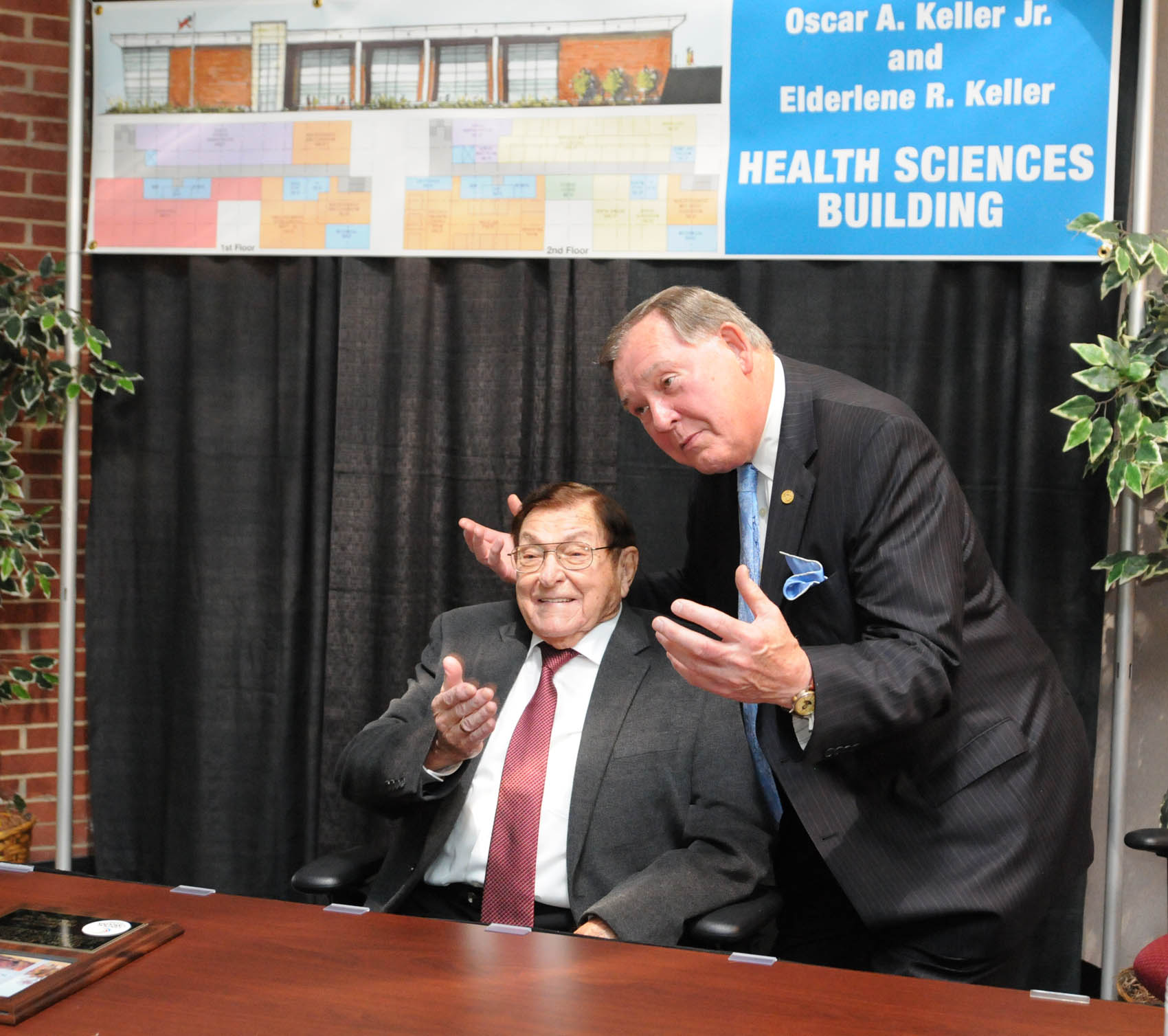 Click to enlarge,  Former North Carolina Secretary of State Rufus Edmisten (right) shares a moment with Oscar A. Keller Jr. at the Oscar A. Keller Jr. and Elderlene R. Keller Health Sciences Building Dedication ceremony.