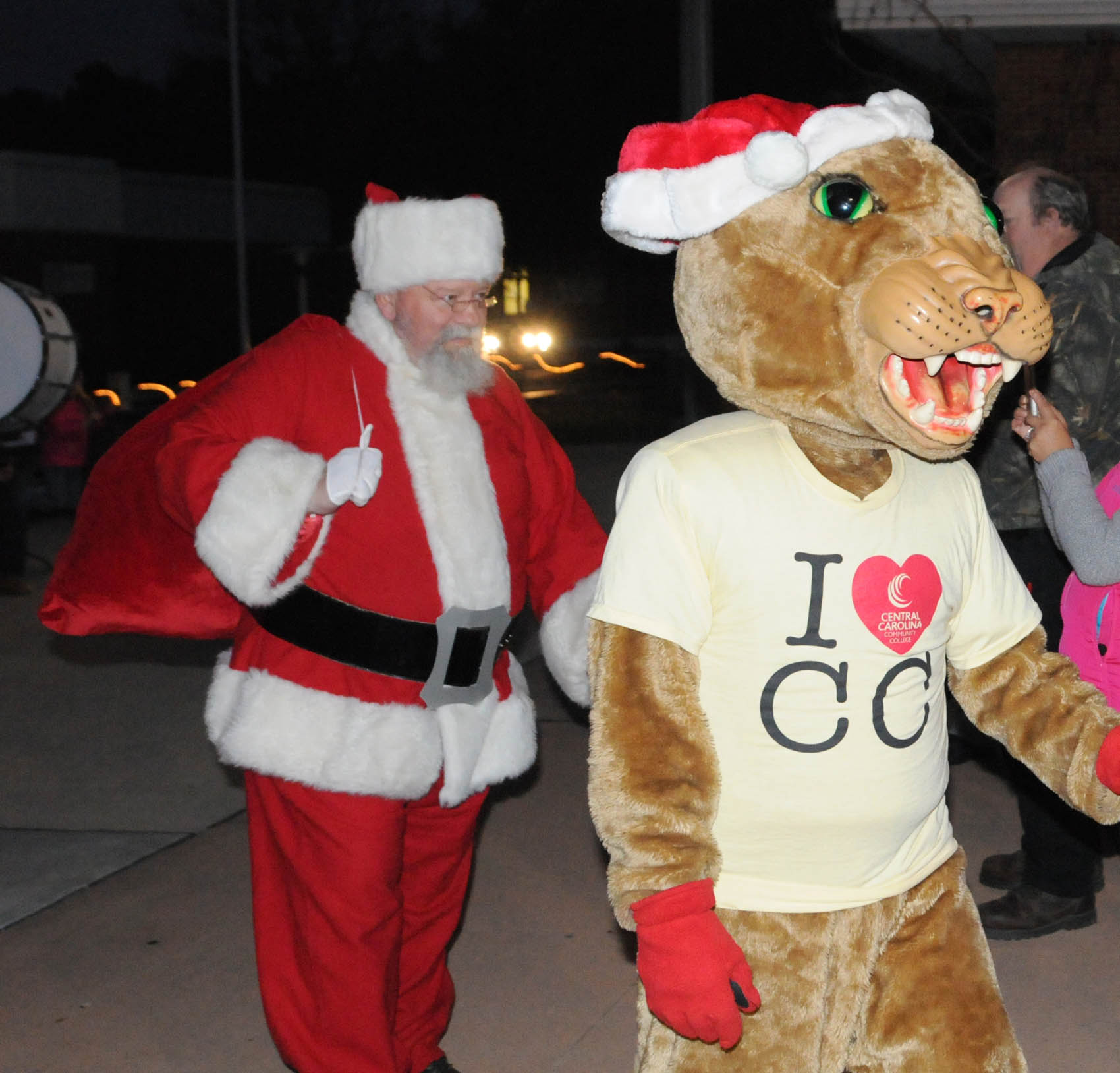 Click to enlarge,  Santa and Charlee Cougar, the Central Carolina Community College mascot, arrives at the CCCC Third Annual Christmas Tree Lighting celebration.
