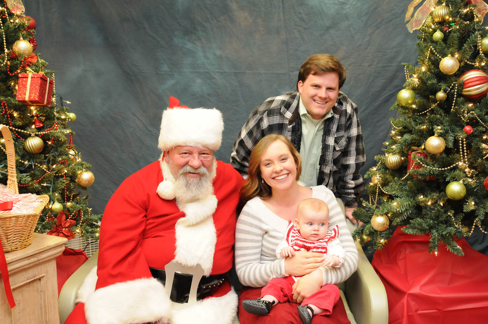 Click to enlarge,  Santa visits with 4-month-old Margaret Carr and her parents, Mitchell and Khala, at the CCCC Third Annual Christmas Tree Lighting celebration.