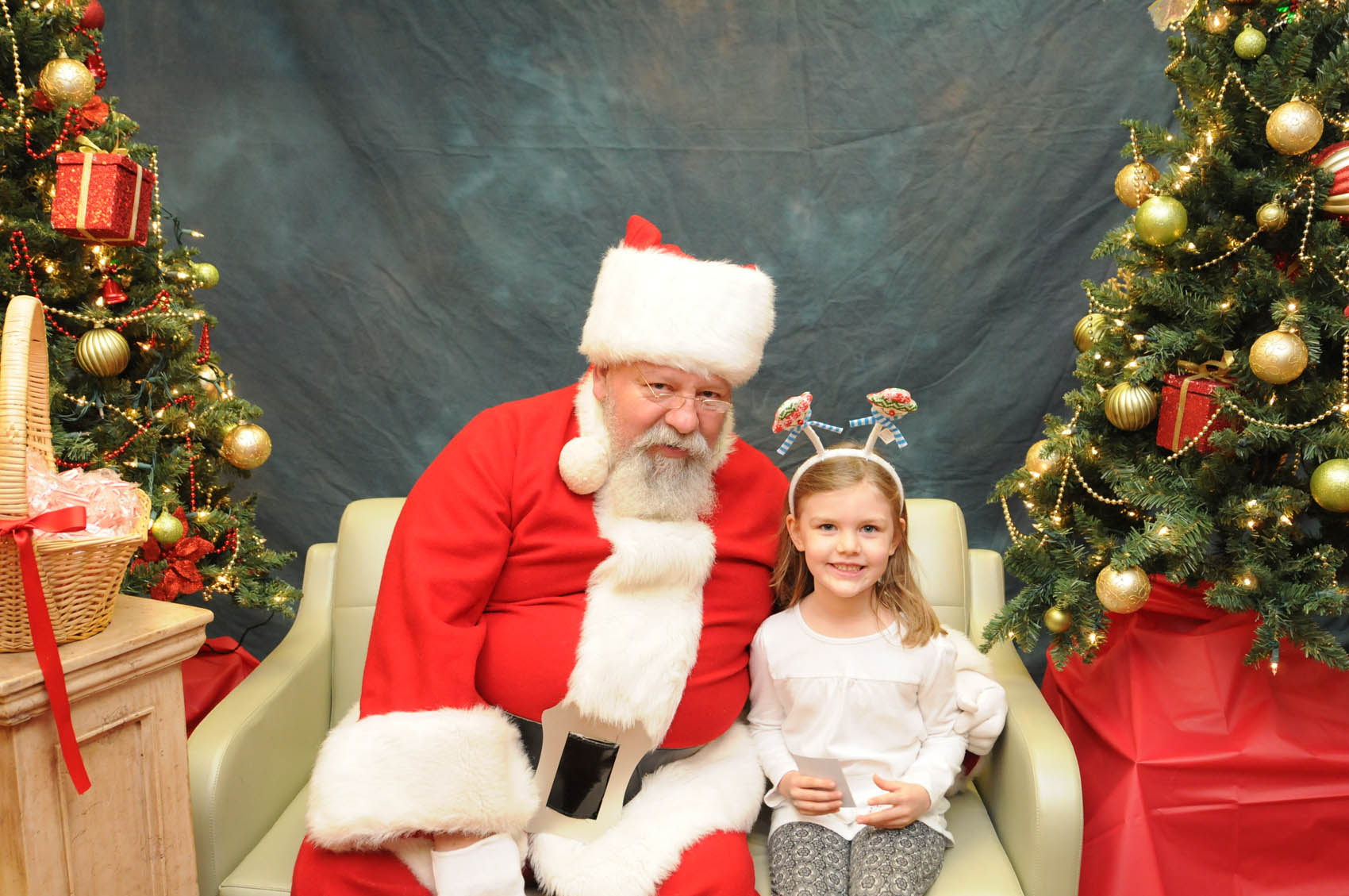 Click to enlarge,  Santa visits with 5-year-old Leah Stiffler, daughter of Andrew and Jamee Stiffler, at the CCCC Third Annual Christmas Tree Lighting celebration.