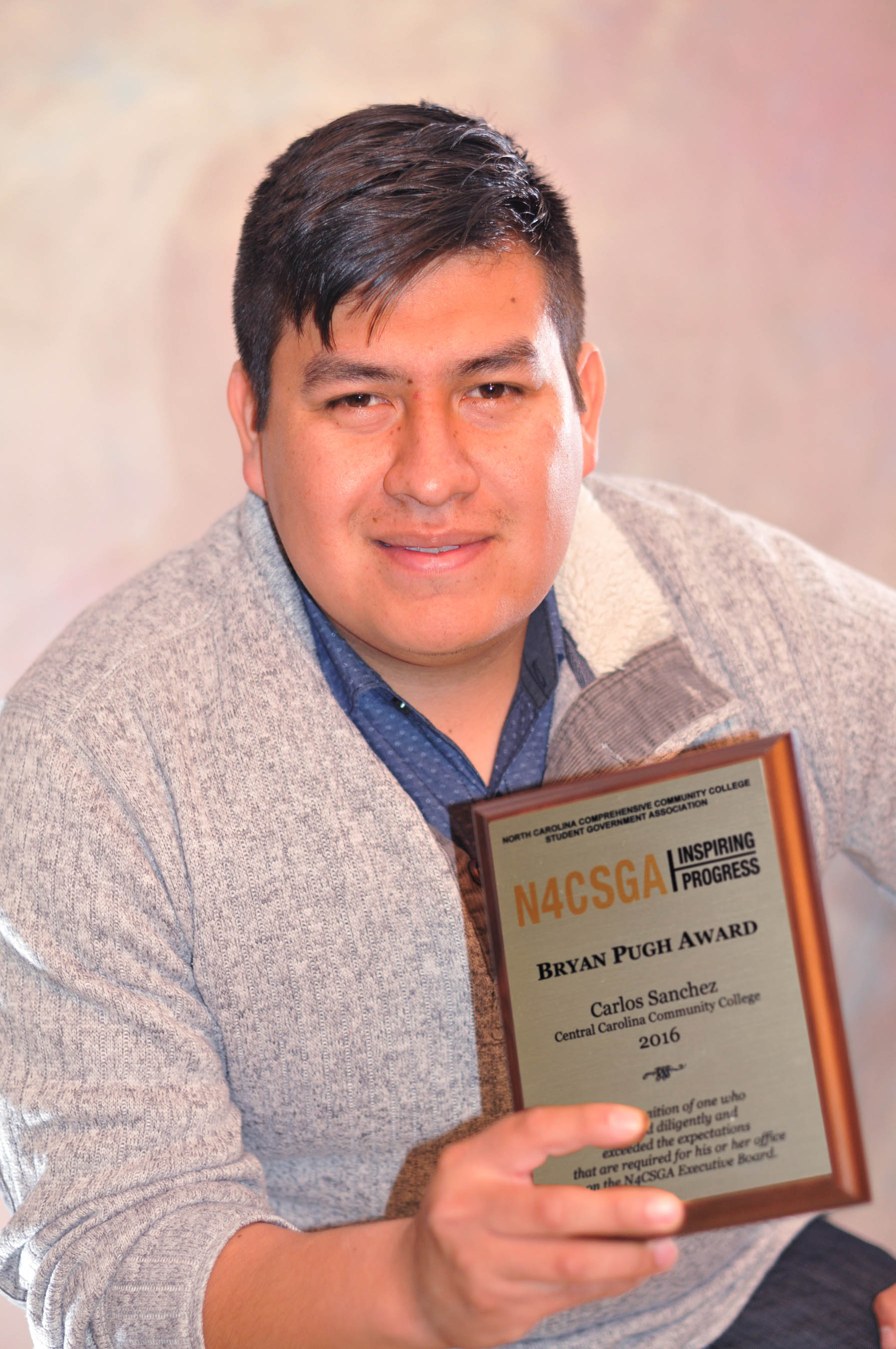 Click to enlarge,  Central Carolina Community College Student Government Association President Carlos Sanchez-Mendez of Siler City recently received the Bryan Pugh Award during the spring conference of the North Carolina Comprehensive Community College Student Government Association (N4CSGA).