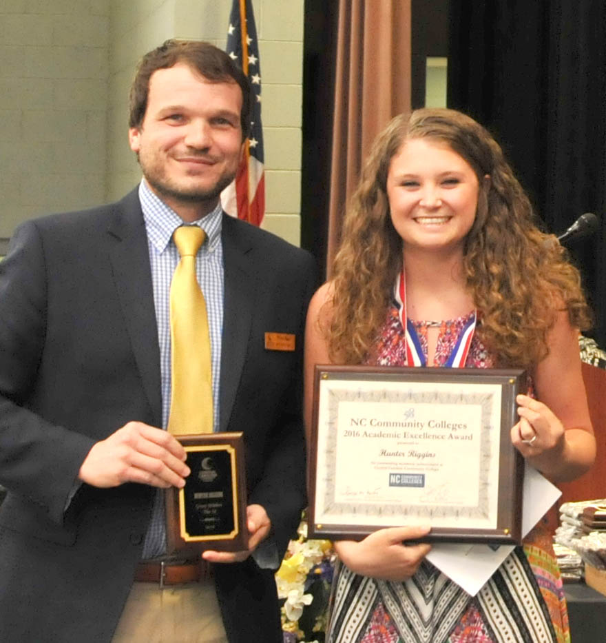 Click to enlarge,  Hunter Riggins (right) is Central Carolina Community College's winner of the N.C. Community College System's Great Within the 58 Academic Excellence Award winner. Presenting the award to Phillips is Mike Beck, CCCC Dean of Student Learning.