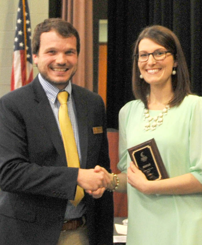 Click to enlarge,  Megan Blair (right) is Central Carolina Community College's nominee for the N.C. Community College System's Gov. Robert Scott Award. Presenting the award to Blair is Mike Beck, CCCC Dean of Student Learning.