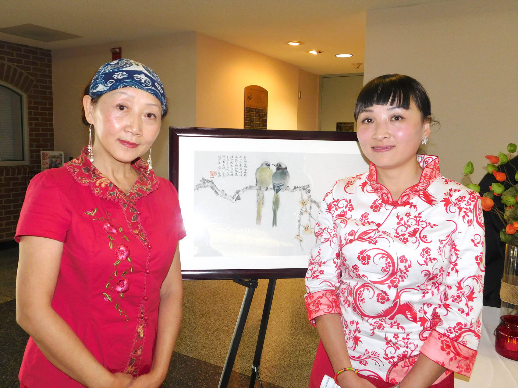 Click to enlarge,  Guan Wang (right), who is the Central Carolina Community College Confucius Classroom Instructor, is pictured with her mother, Feiyan Liu (left), during a Chinese Art Exhibition held at CCCC.