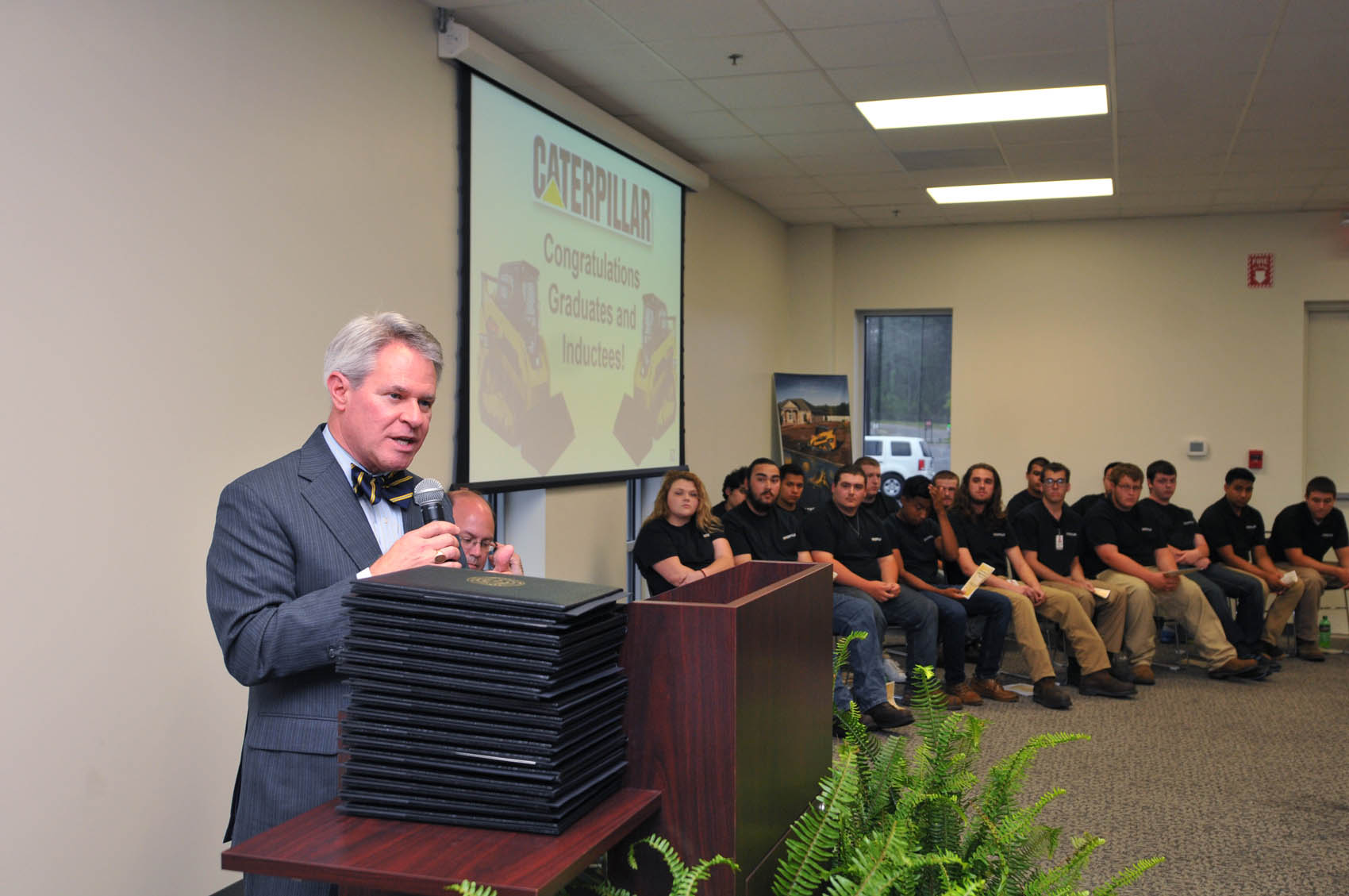 "Click to enlarge,  Dr. James C. ""Jimmie"" Williamson, President-elect of the N.C. Community College System, presented the keynote remarks at the Caterpillar Youth Apprentice Program graduation and induction."