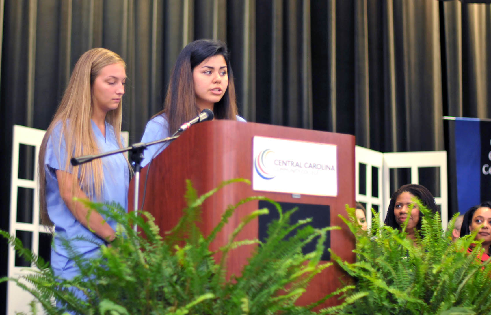 Click to enlarge,  Brooke Madison and Zuheryi Lievano, of Harnett County, were among the student speakers at the Central Carolina Community College Continuing Education medical programs graduation. The event was held May 26 at the Dennis A. Wicker Civic Center in Sanford. For more information about Continuing Education medical programs, call Lennie Stephenson, CCCC's Director of Continuing Education medical programs, at 910-814-8833 or email lstephenson@cccc.edu.