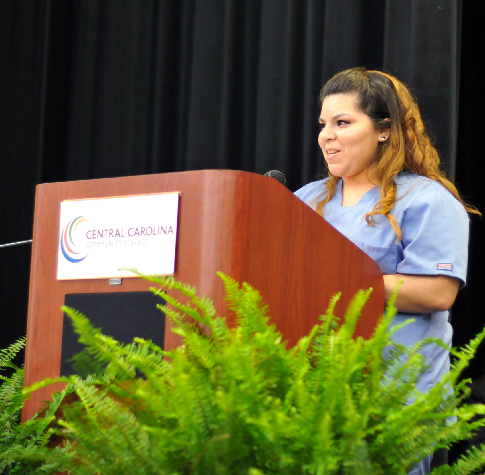 Click to enlarge,  Jessica Abrego, of Chatham County, was one of four student speakers at the Central Carolina Community College Continuing Education medical programs graduation. The event was held May 26 at the Dennis A. Wicker Civic Center in Sanford. For more information about Continuing Education medical programs, call Lennie Stephenson, CCCC's Director of Continuing Education medical programs, at 910-814-8833 or email lstephenson@cccc.edu.