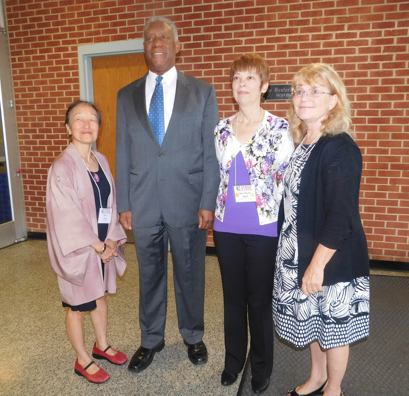 Click to enlarge,  NC STRIVE Conference Planning Committee leaders visit with Secretary Cornell A. Wilson, Jr. (second from left), N.C. Department of Military and Veterans Affairs, Major General, USMC (Ret.). Pictured are, left to right:  Co-Chair Dr. Wei Li Fang of the Governor's Institute on Substance Abuse, Sec. Wilson, Co-Chair Ann Marie Beall of the University of North Carolina at Wilmington, and Chair Susan Watkins of the U.S. Department of Veterans Affairs.