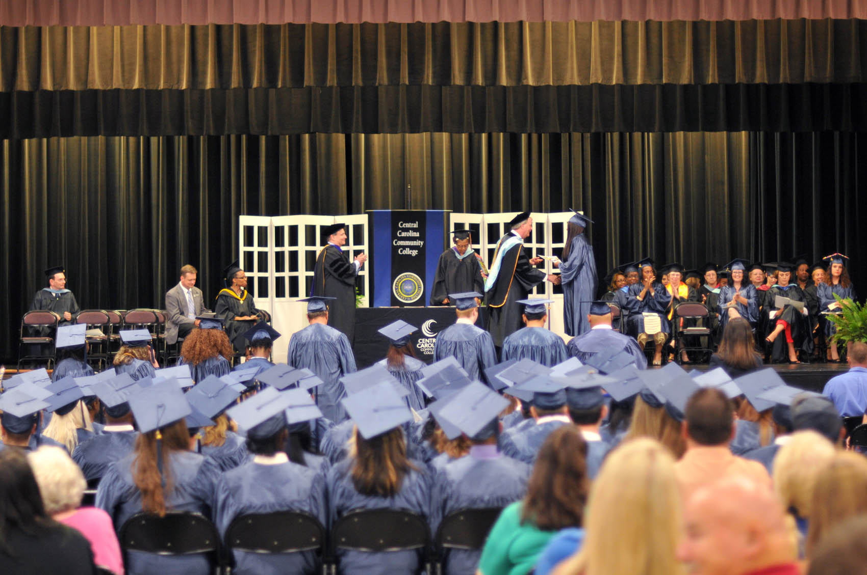Click to enlarge,  Central Carolina Community College's College and Career Readiness Commencement Exercises was a huge celebration. The June 16 event at the Dennis A. Wicker Civic Center honored the achievements of more than 100 students.