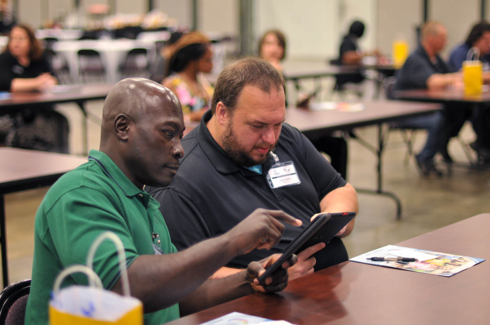 Click to enlarge,  Central Carolina Community College students Christopher Barnes and Morgan Adams participate in the FutureWork Prosperity Tour 2016 program held Wednesday, June 22, at the Dennis A. Wicker Civic Center in Sanford.