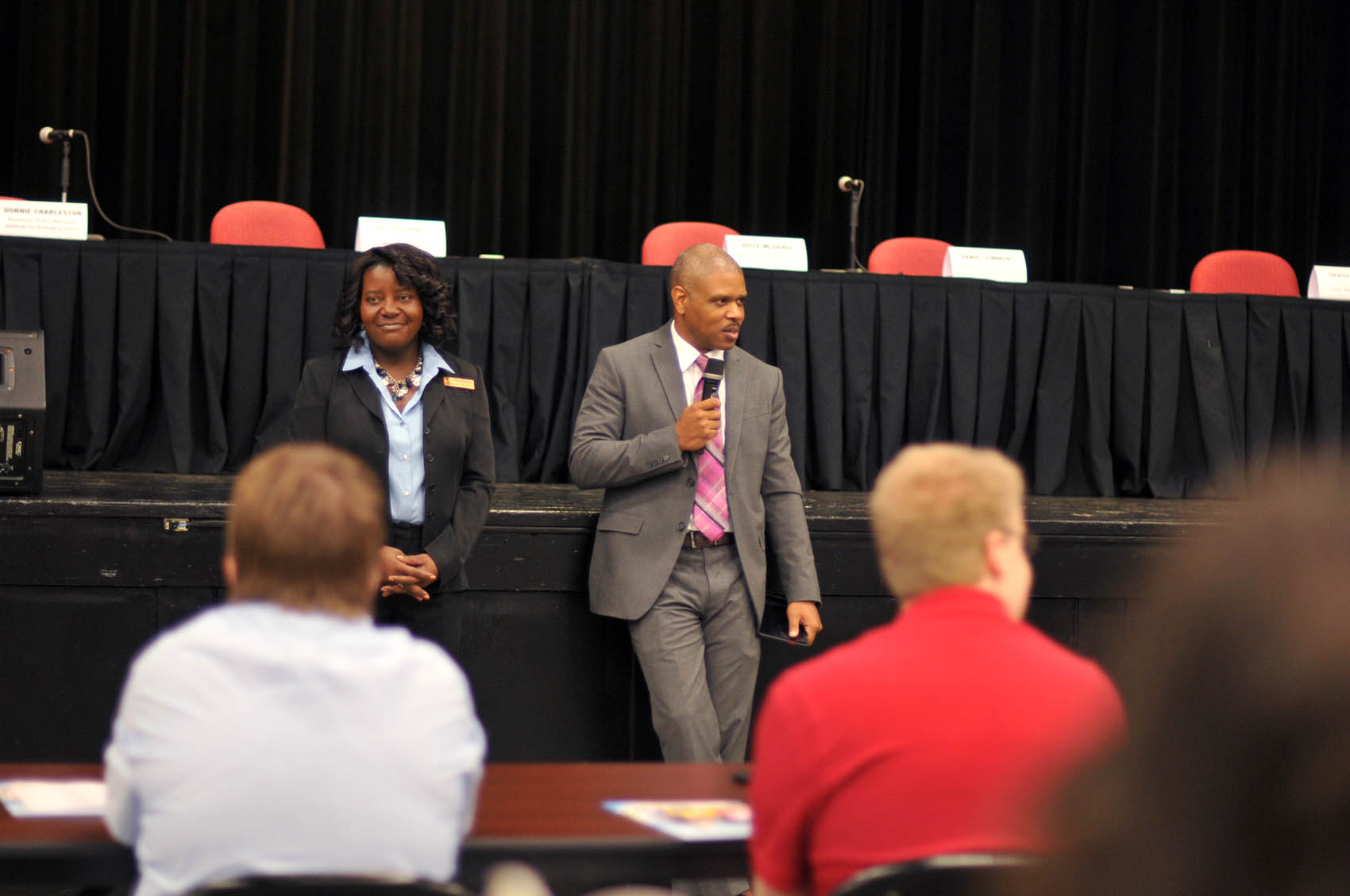 Click to enlarge,  Mary Parker, CCCC Career Center Coordinator, and Donnie Charleston, Economy Policy Manager, Institute for Emerging Issues, speak to the participants of the FutureWork Prosperity Tour 2016 event on Wednesday, June 22, at the Dennis A. Wicker Civic Center in Sanford.