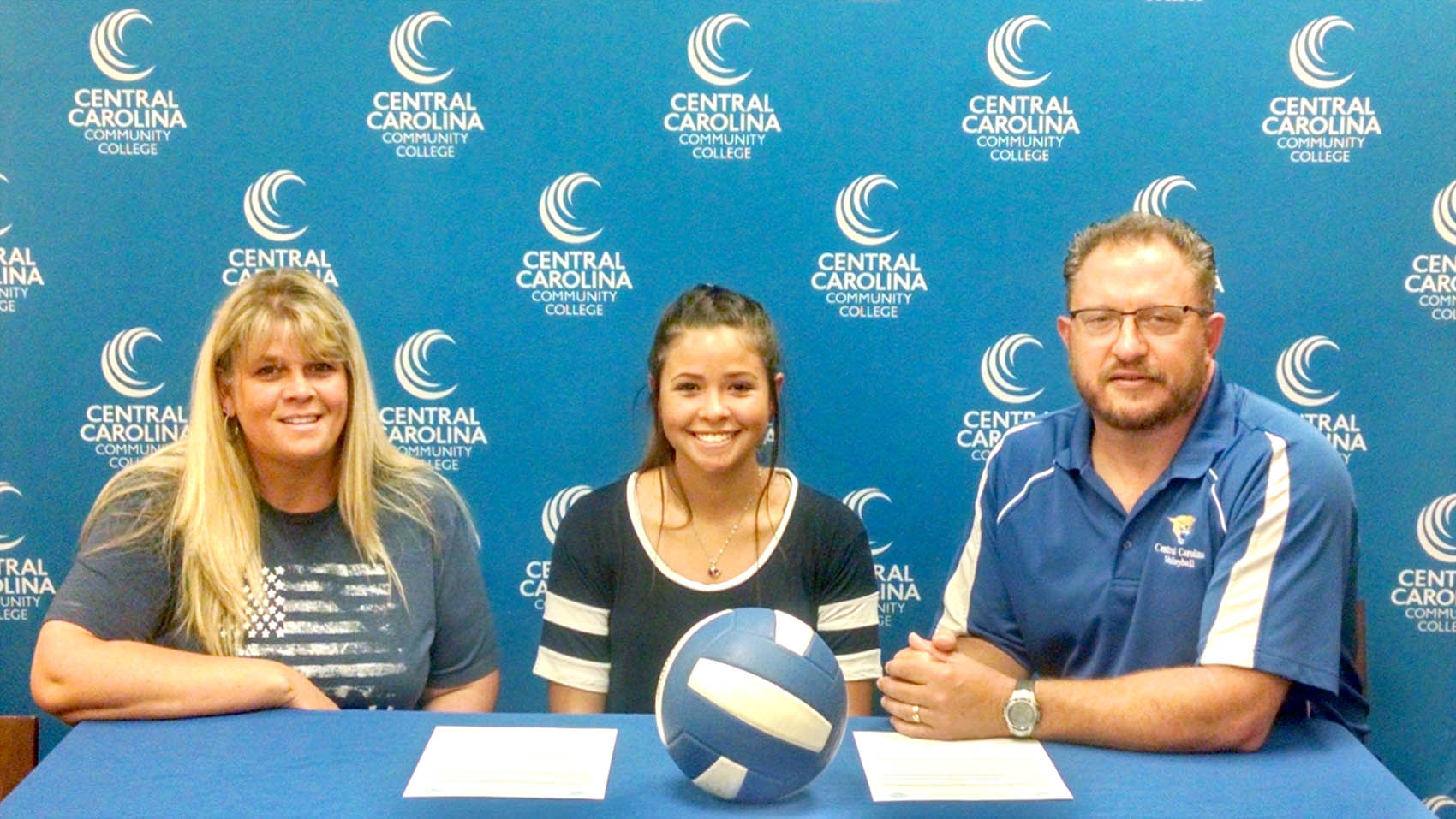 Click to enlarge,  Alexis Mackenzie (center) will join the Central Carolina Community College volleyball program. Also pictured are Alexis Mackenzie's mother, Lisa (left), and CCCC Volleyball Coach Bill Carter.