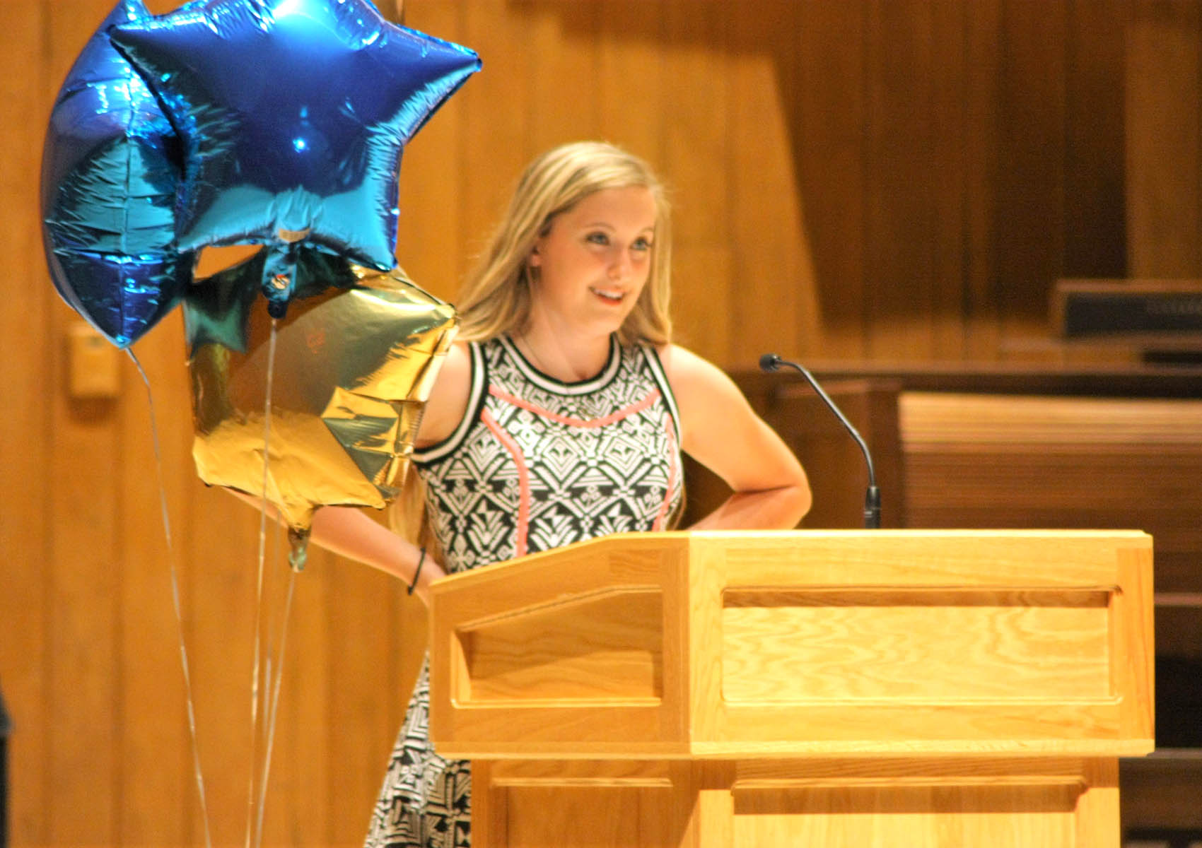 Click to enlarge,  Alyssa Cochran-Trull, rising junior at Western Harnett High School, addresses the audience to share about her experience with Upward Bound Math and Science.