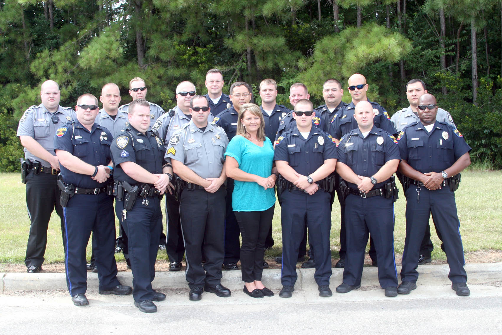 Click to enlarge,  Recent graduates of the Lee County Crisis Intervention Team training program were, left to right: front row, William Gardner, Anthony Norton, Kenneth Gilstrap, Audrey Baker, Mitchell Coggins, Johnathan Dorman and William Heck; back; row, Zachary Petty, Jerod Kirk, Mitchell Ashley, William Malan, Kenneth Hair, Kenneth Ott, Nathan Snyder, Billy Rodgers, William Kidd, James Young and Charles Jordan. Not pictured is Tyler Bridges.