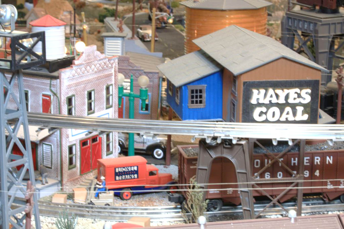 Click to enlarge,  Richard Hayes' train layout took two years to build on weekends as he traveled during the week. 'My train layout ... I fashioned after both the downtown Sanford train station and Hayes Coal Company and train yard environs, to an imagined rural country side and farm scenes traversed by the trains, turning into a mountain section with tunnels and bridges for the trains to negotiate,' said Hayes.