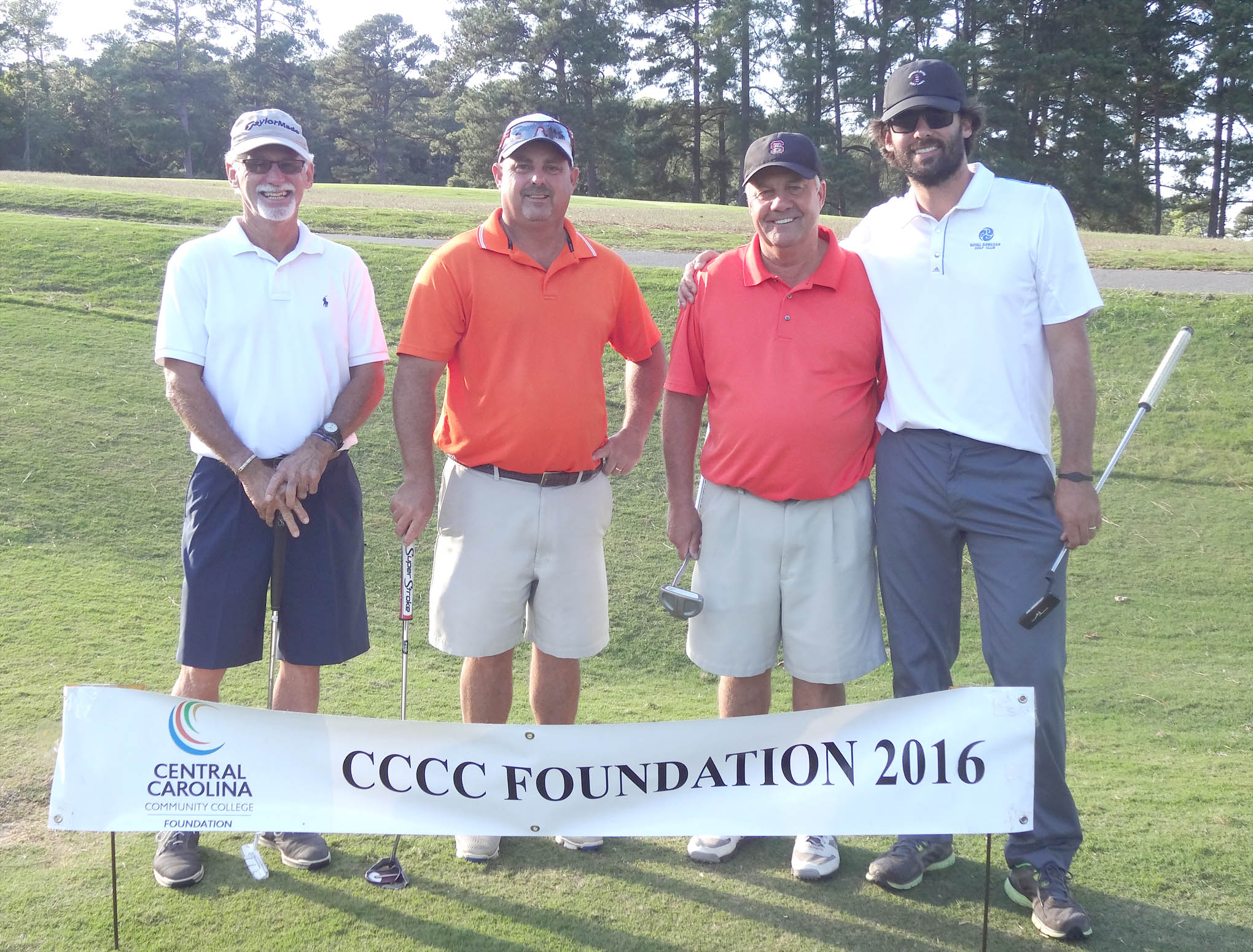 Click to enlarge,  The team of Curtis Salmon, Buck Womack, Robbie Currin, and Stephen Salmon won the second flight of the afternoon tournament of the CCCC Foundation Lee Golf Classic.