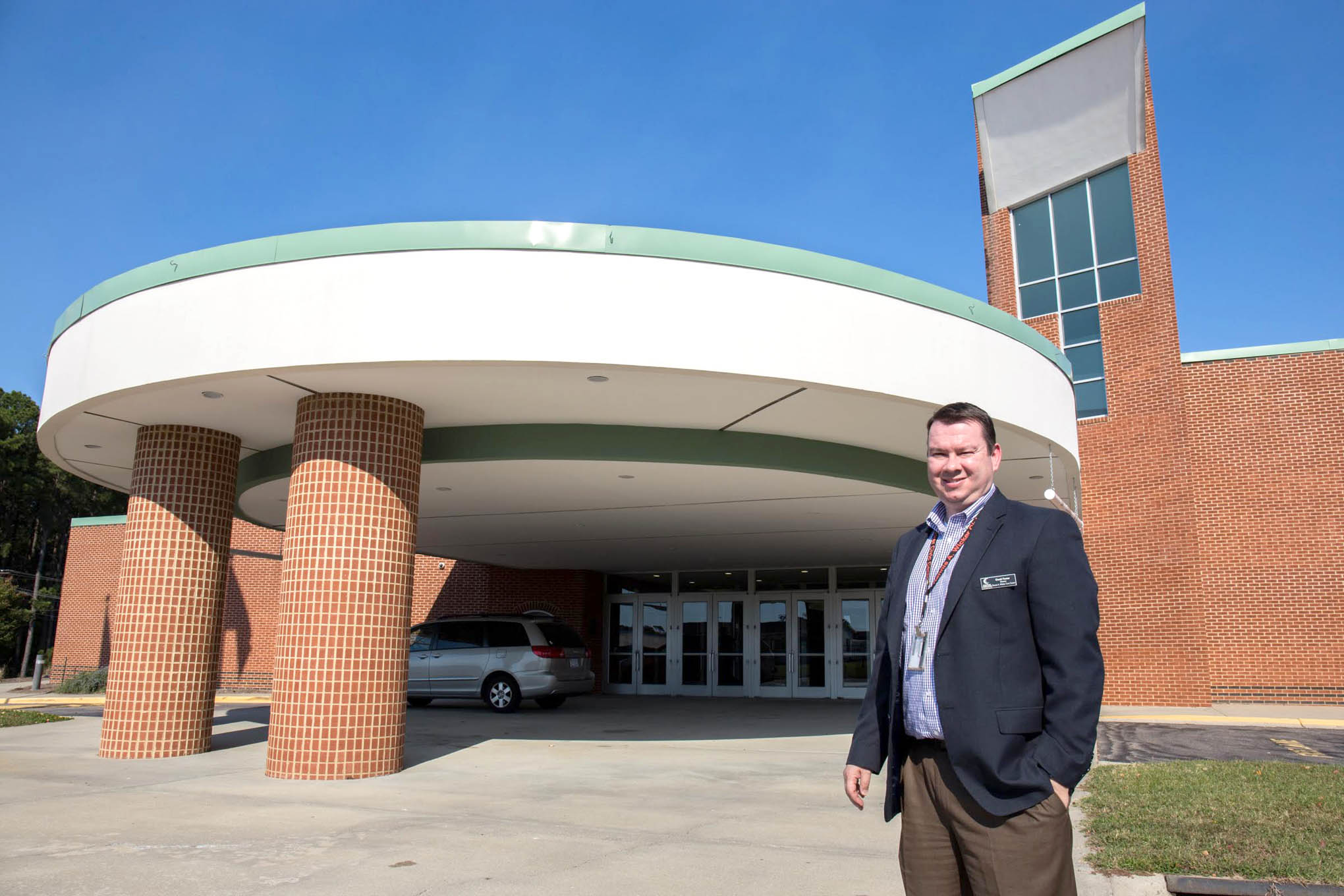 Click to enlarge,  David Foster, director of the Dennis A. Wicker Civic Center, was a student at Lee County Senior High School across the street when the building was being built. Now, he runs operations for the center, which hosts just under 1,000 events a year.