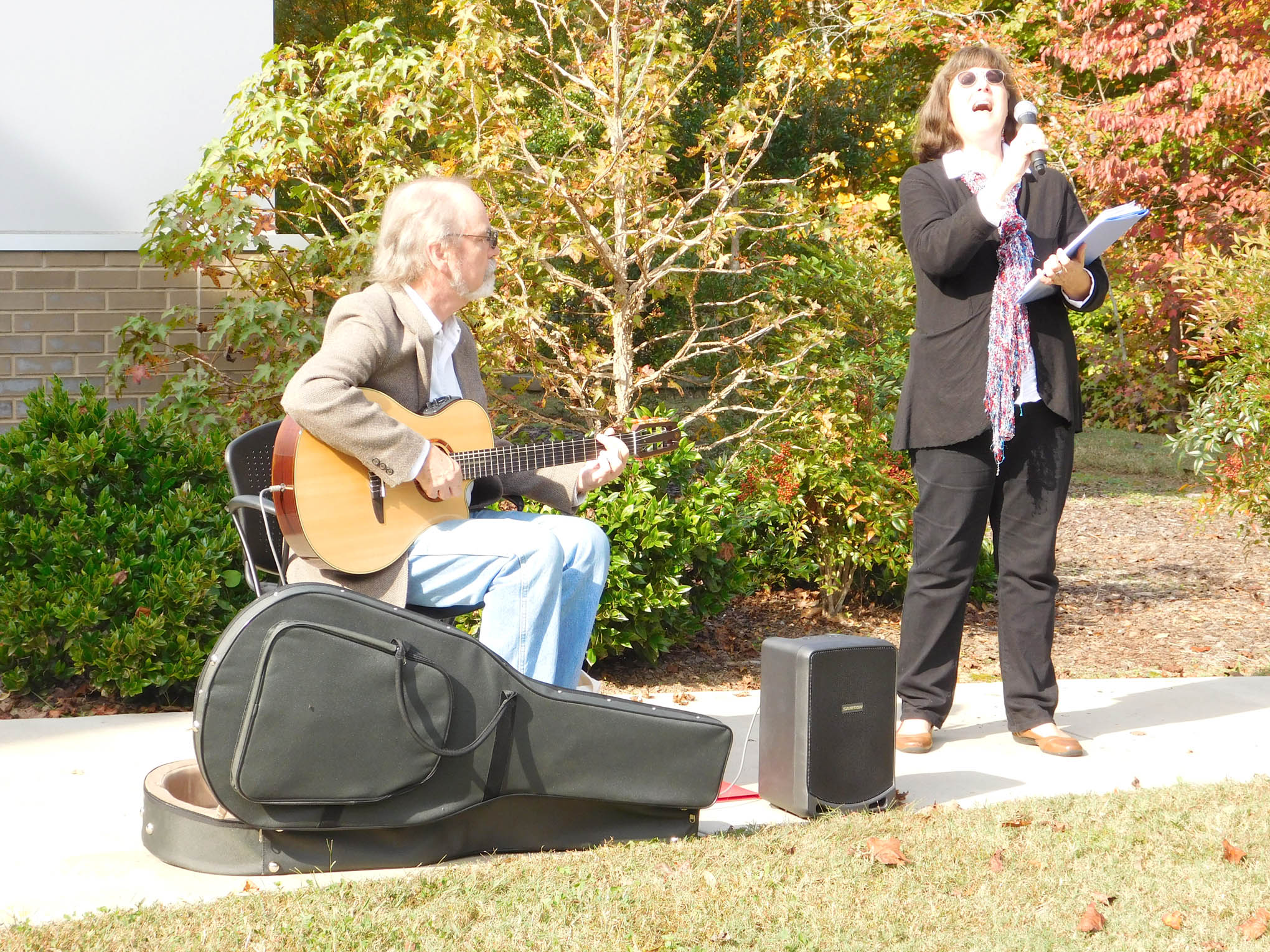 Click to enlarge,  Victoria Chall, vocalist, and Danny Gotham, guitarist, provided music for the Veterans Day program held Nov. 3 at the CCCC Siler City Center.