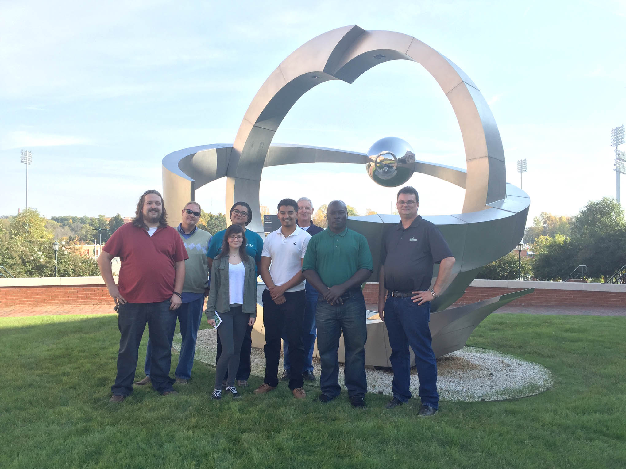 Click to enlarge,  Touring the Optics Research Center on the University of North Carolina at Charlotte's campus were, left to right: Cameron Childress, Scott Parker, Ruth Gietzen, Kyla Ross, Antonio DePaz, Gary Beasley, Christopher Barnes, and Scott Williams.