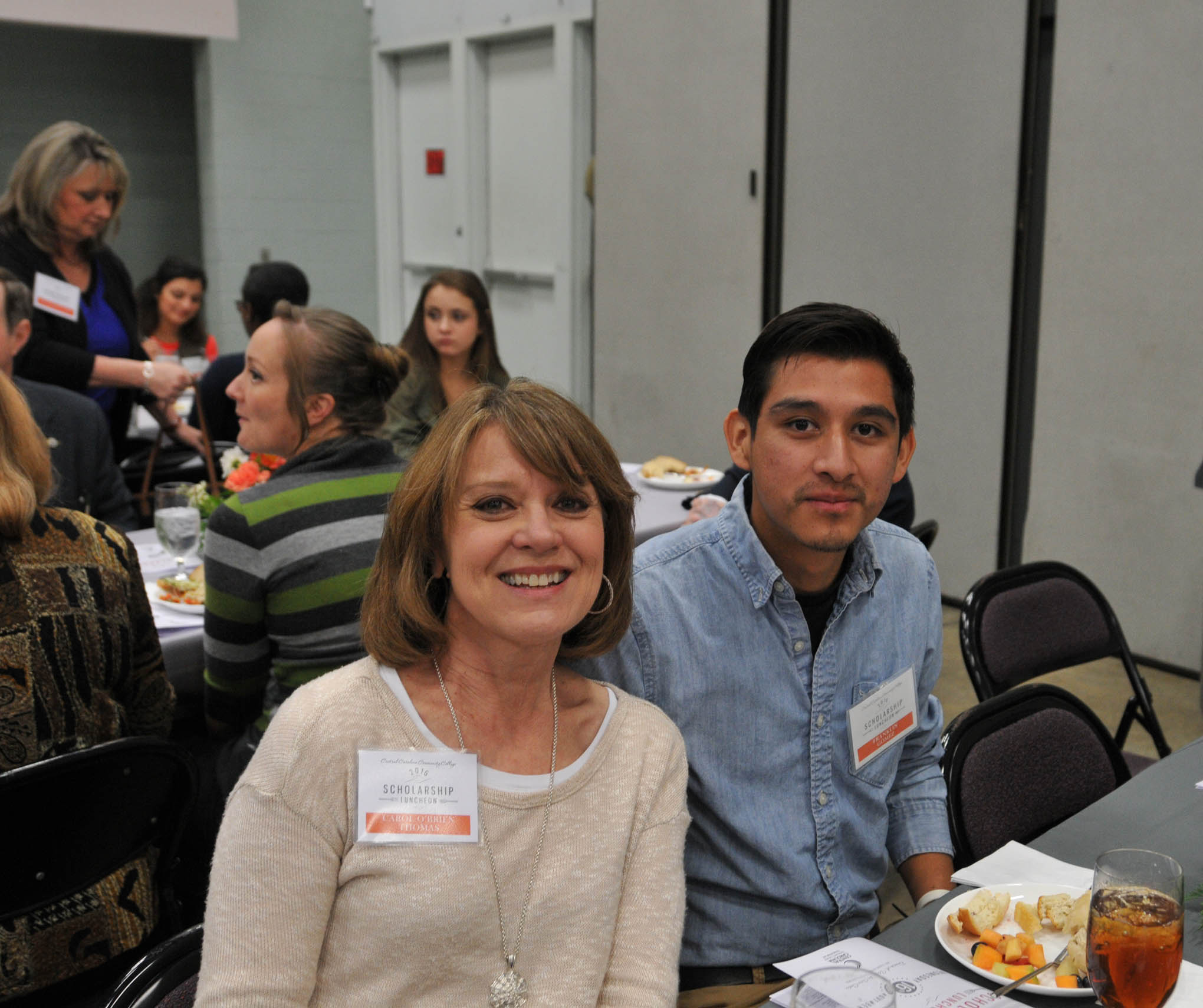 Click to enlarge,  Carol O'Brien Thomas, of Siler City, visits with CCCC scholarship recipient Franklin Gomez during Central Carolina Community College's Scholarship Luncheon on Wednesday, Nov. 16, at the Dennis A. Wicker Civic Center. Thomas was in attendance to represent the scholarship in honor of her late husband, Raymond Francis O'Brien Jr.