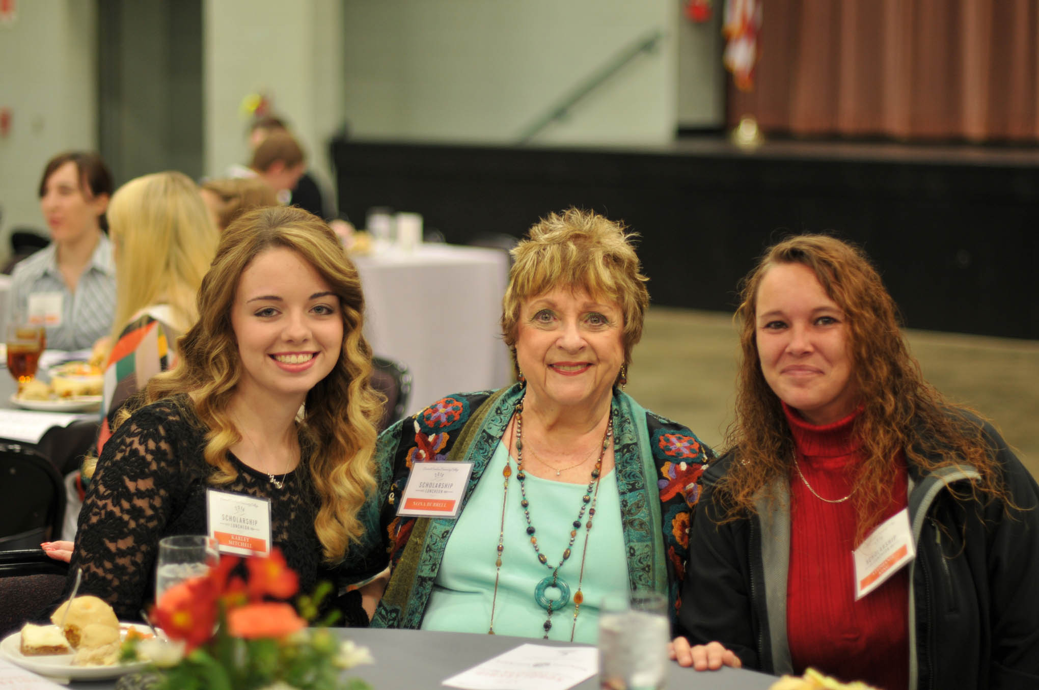 Click to enlarge,  Nona Burrell (center), of Pinehurst, visits with CCCC scholarship recipients Karley Mitchell (left) and Stephanie King (right) during Central Carolina Community College's Scholarship Luncheon on Wednesday, Nov. 16, at the Dennis A. Wicker Civic Center. Burrell was in attendance to represent the Nona Burrell/Nomar's Kennel Scholarships, as well as the Moore County Kennel Club Veterinary Medicine Technology Scholarships.
