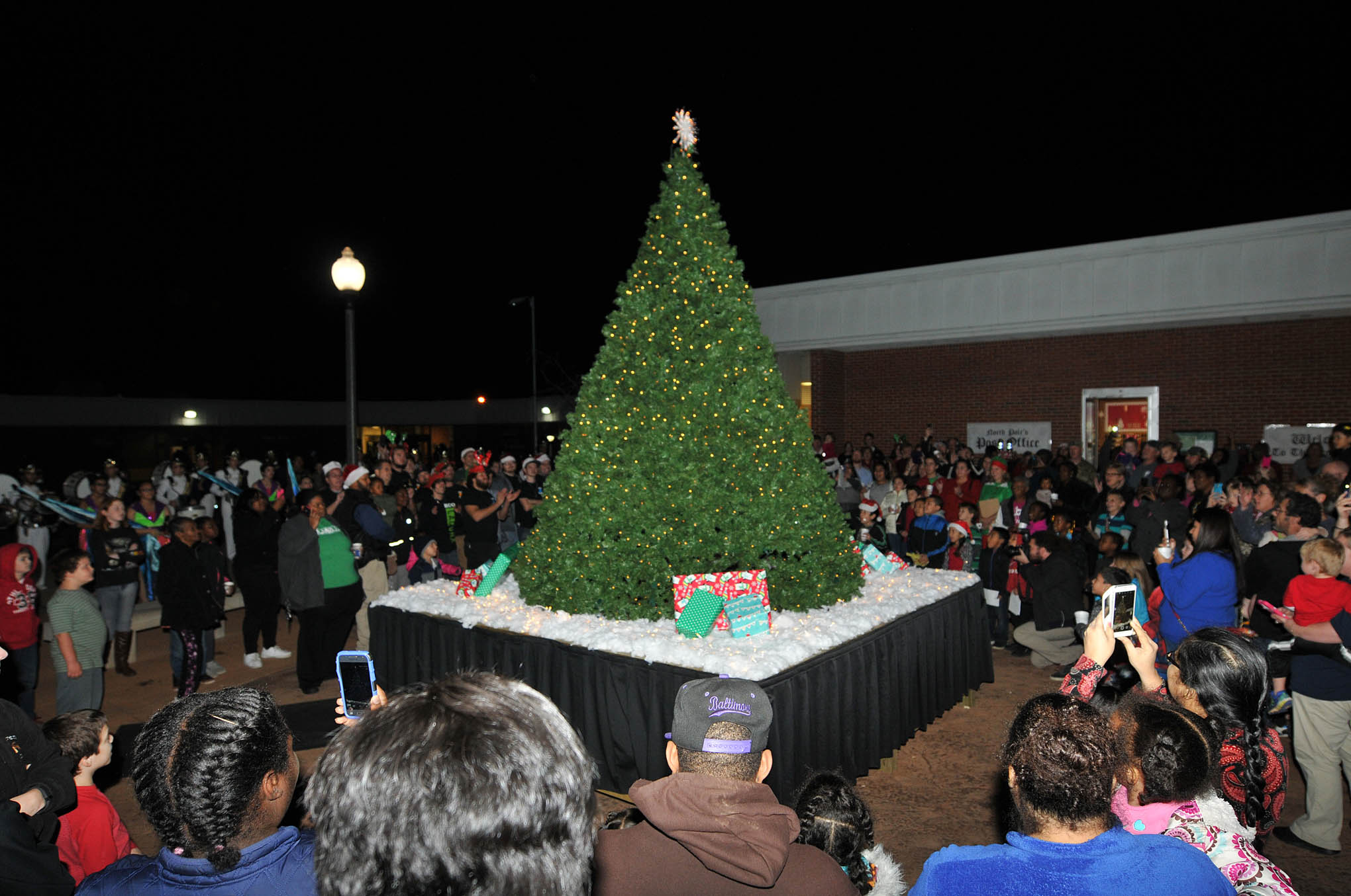 Click to enlarge,  Children and their families counted down to the moment when the Christmas tree suddenly glowed with its bright lights at the CCCC Fourth Annual Christmas Tree Lighting celebration.