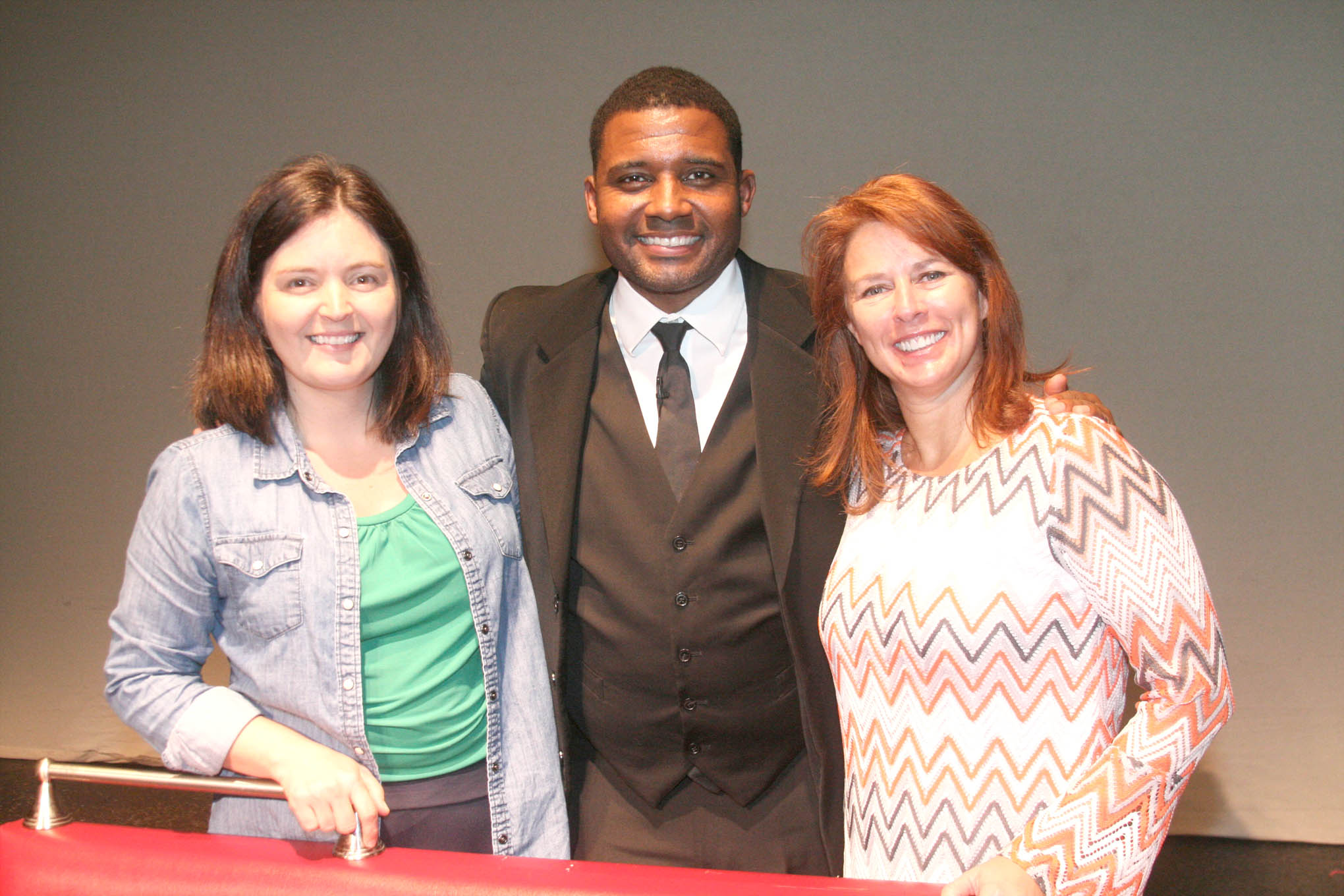Click to enlarge,  Professional actor Mike Wiley (center) visits with CCCC Social Sciences Lead Instructor Bianka Stumpf (left) and Temple Theatre Producing Artistic Director Peggy Taphorn.