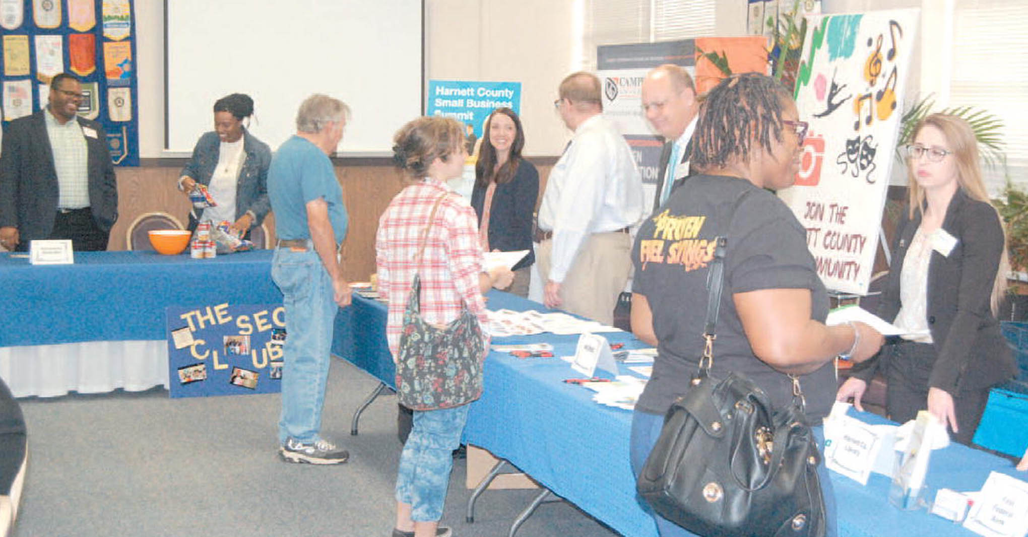 Click to enlarge,  Rick Curl, The Daily Record. Small business owners and resources aimed at helping them flourish took part in the Harnett County Small Business Summit at the Triangle Enterprise Center in Dunn. Above, representatives of participating agencies and interested visitors share ideas and information.