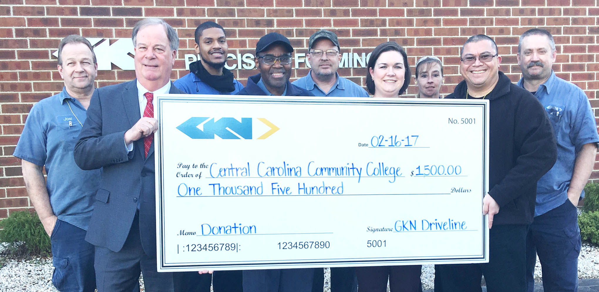 "Click to enlarge,  The Central Carolina Community College Foundation has received a $1,500 contribution from GKN Driveline of Sanford. Accepting the check is CCCC President Dr. T. Eston Marchant (second from left) and CCCC Foundation Executive Director Emily Hare (sixth from left). ""The CCCC Foundation is appreciative for GKN Driveline's continued support,"" said Hare. Also pictured are GKN employees. The CCCC Foundation is a 501(c)(3) charitable organization affiliated with, but independent of, Central Carolina Community College. It receives donations of money and equipment on behalf of the college and uses them to promote its educational mission and assist students through scholarships and grants. For more information on the CCCC Foundation, contact Foundation Executive Director Emily Hare at 919-718-7230 or by email at ehare@cccc.edu."