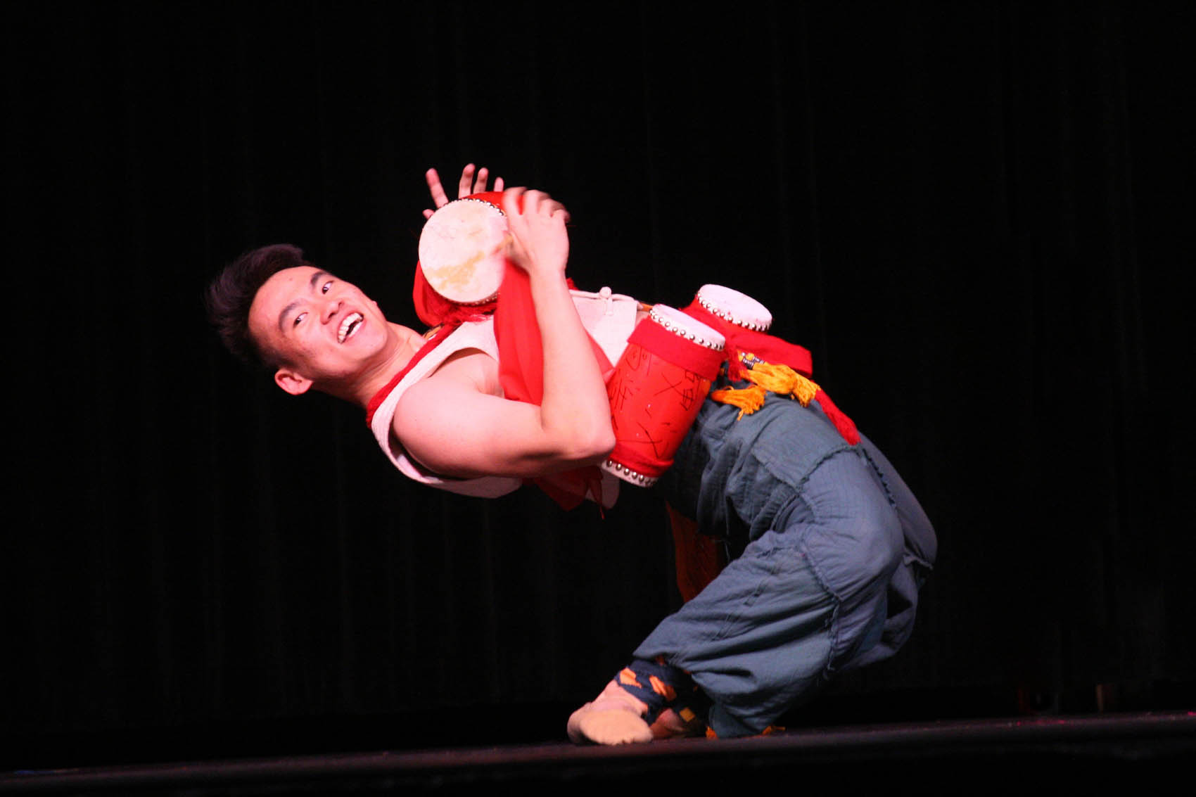 "Click to enlarge,  Yang Yijie performs ""Drums for Fun,"" an acrobatic duet with dance partner Chen Bocheng that was one of 10 performances drawing rave reviews from an appreciative audience in Sanford."