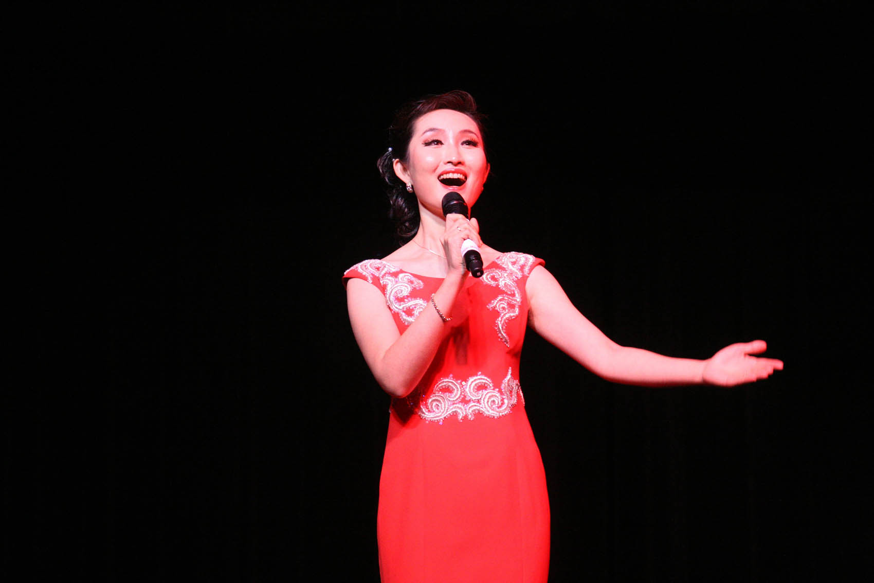 "Click to enlarge,  Soprano soloist Zhou Na from Shanxi University performs ""Mayeel Variations"" during an afternoon of Chinese music and dance at the Dennis A. Wicker Civic Center in Sanford."