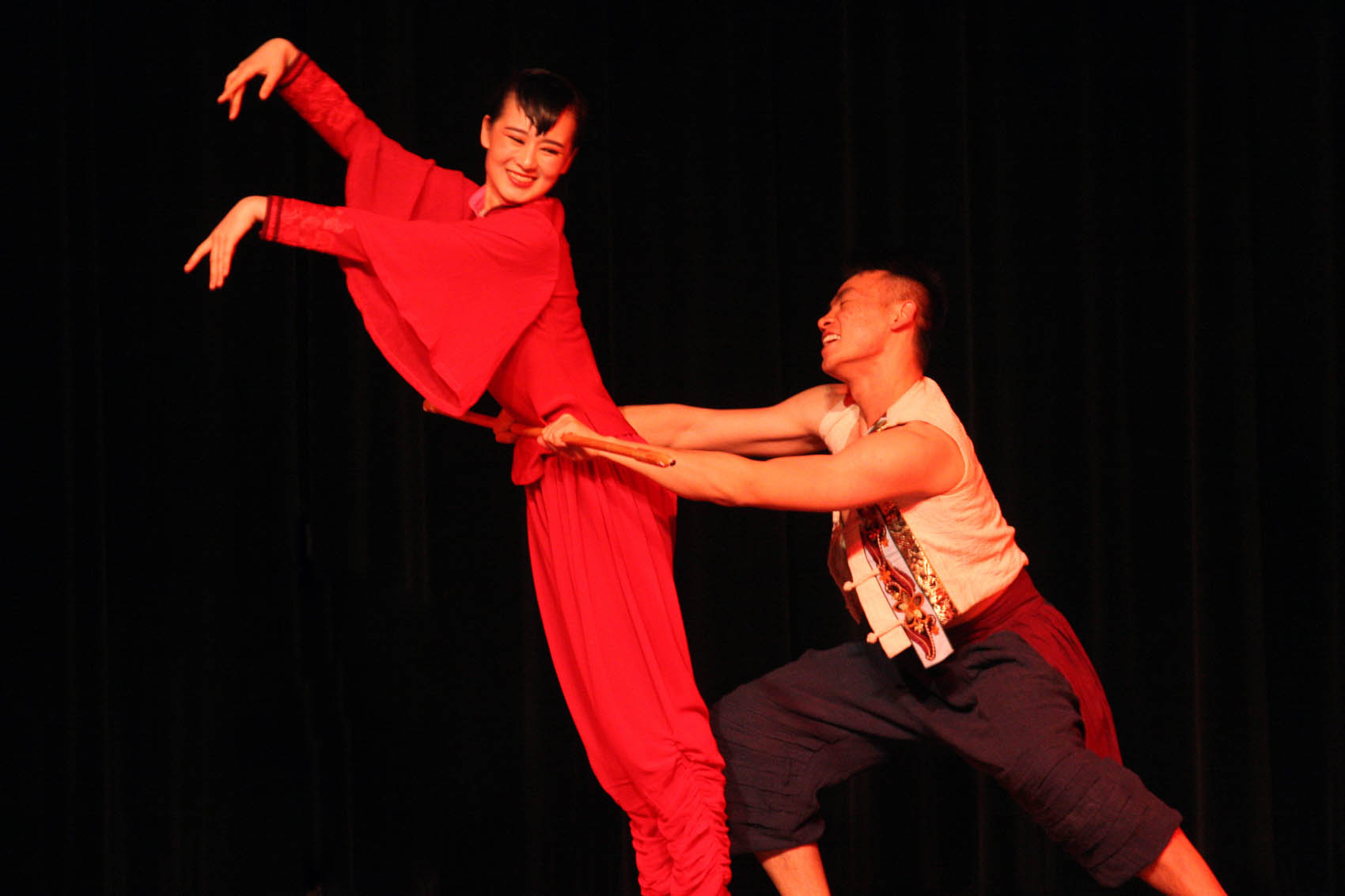 "Click to enlarge,  Hu Xuedong, left, and Yang Yijie perform a dance duet, ""Red Sorghum,"" as part of a lively afternoon of dance and music presented by artists from Shanxi University in China."