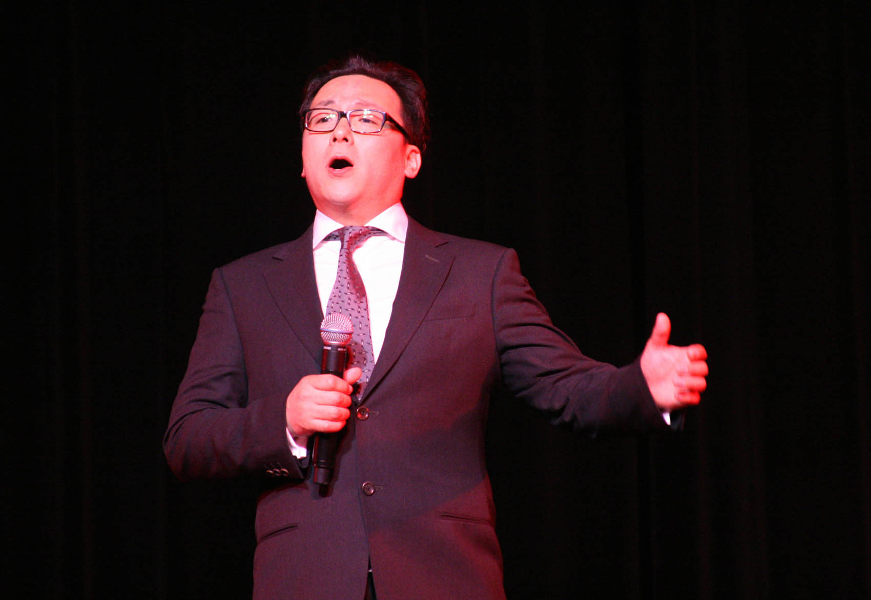 "Click to enlarge,  Tenor soloist Li Yanfeng performs ""Shanxi Pastoral Song,"" the first vocal number in an hour-long performance by Shanxi University artists that dazzled a packed house at the Dennis A. Wicker Civic Center."