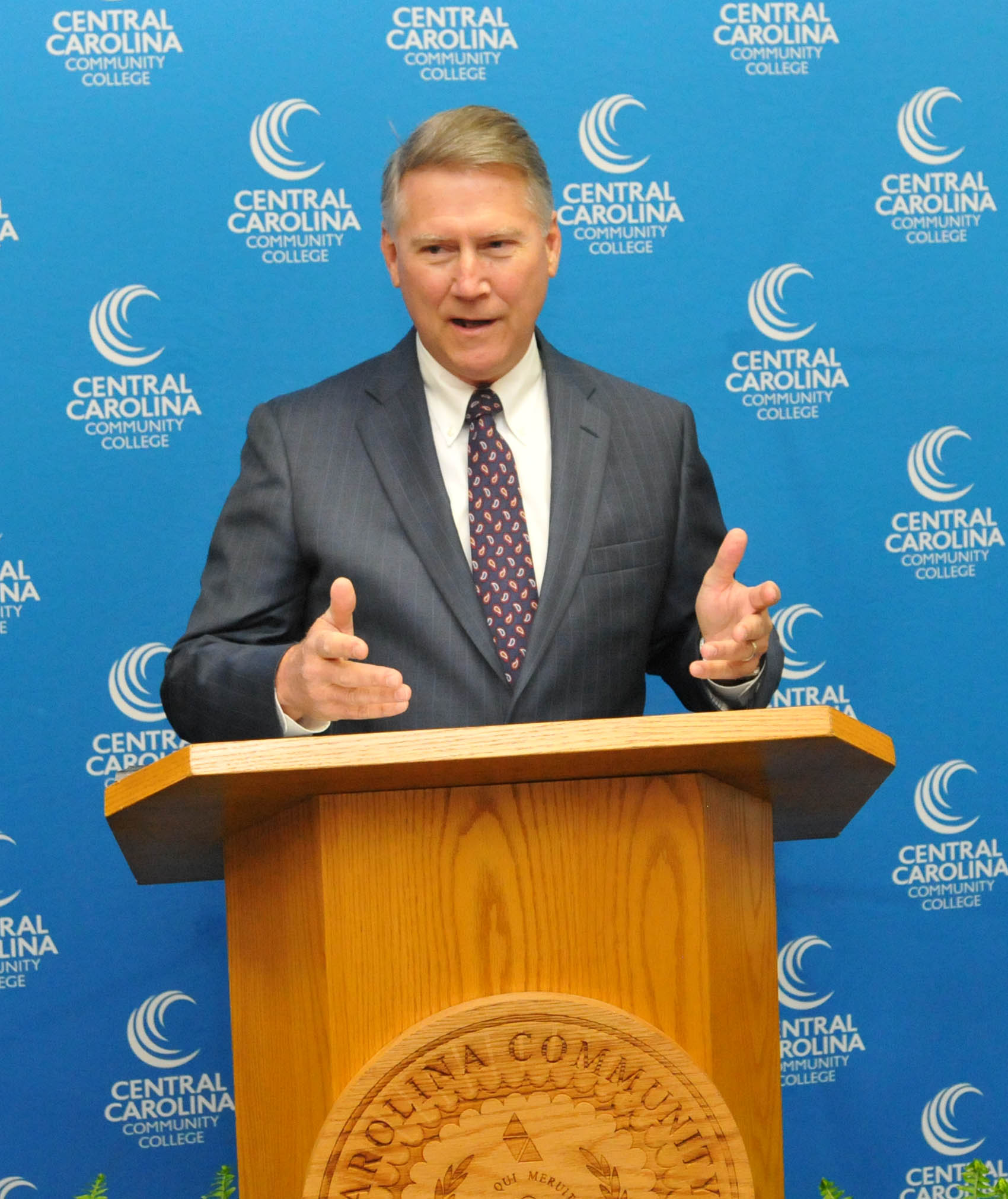 Click to enlarge,  Former North Carolina Lt. Gov. Dennis Wicker spoke at the dedication of Central Carolina Community College's Department of Paralegal Studies in honor of the late William W. and Ellen B. Staton of Sanford.