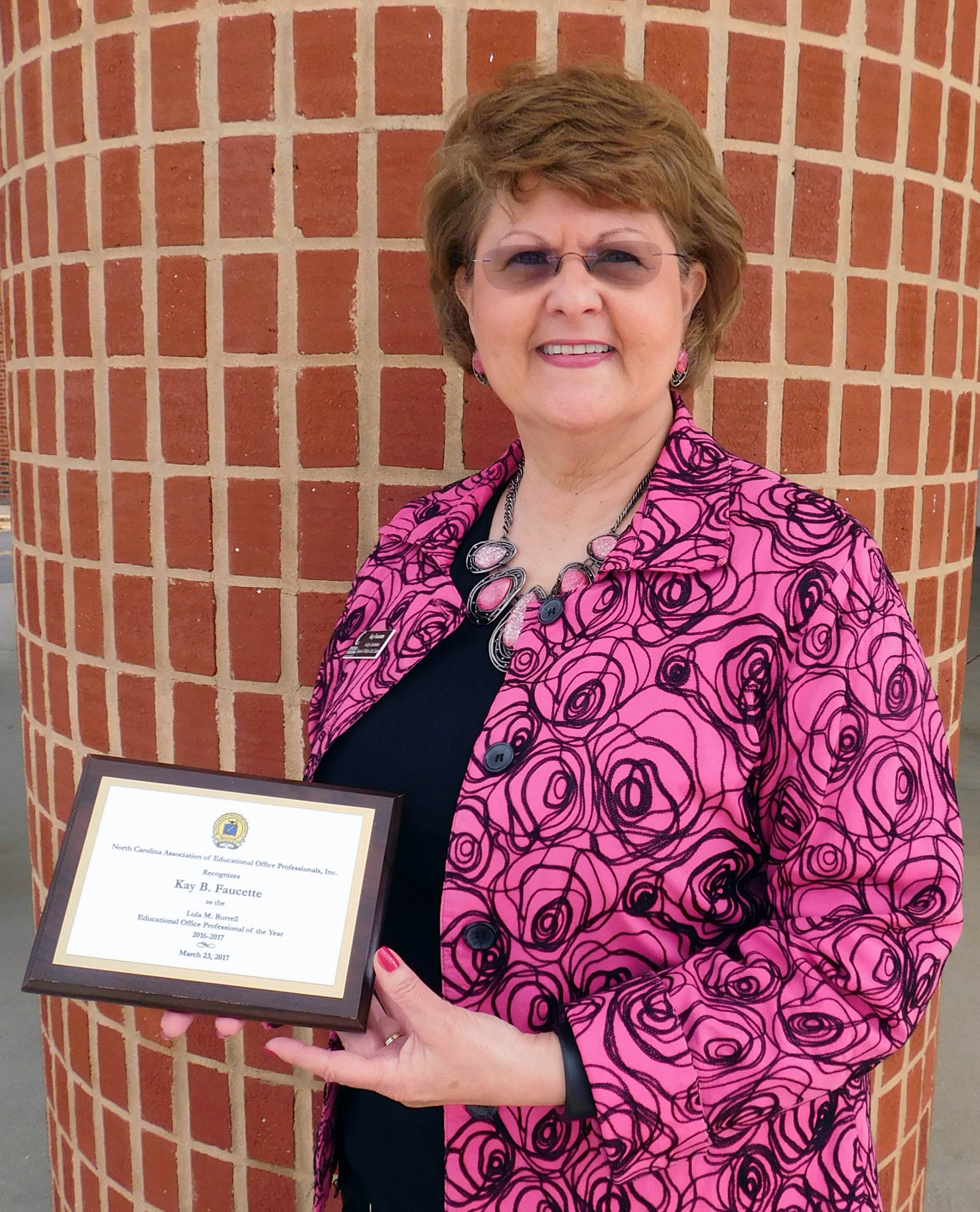 Click to enlarge,  Kay B. Faucette, Facility Coordinator for the Dennis A. Wicker Civic Center, has been awarded the Lula M. Burrell Educational Office Professional of the Year 2016-2017 by the N.C. Association of Educational Office Professionals, Inc. The award was presented on Thursday, March 23, in Winston-Salem.