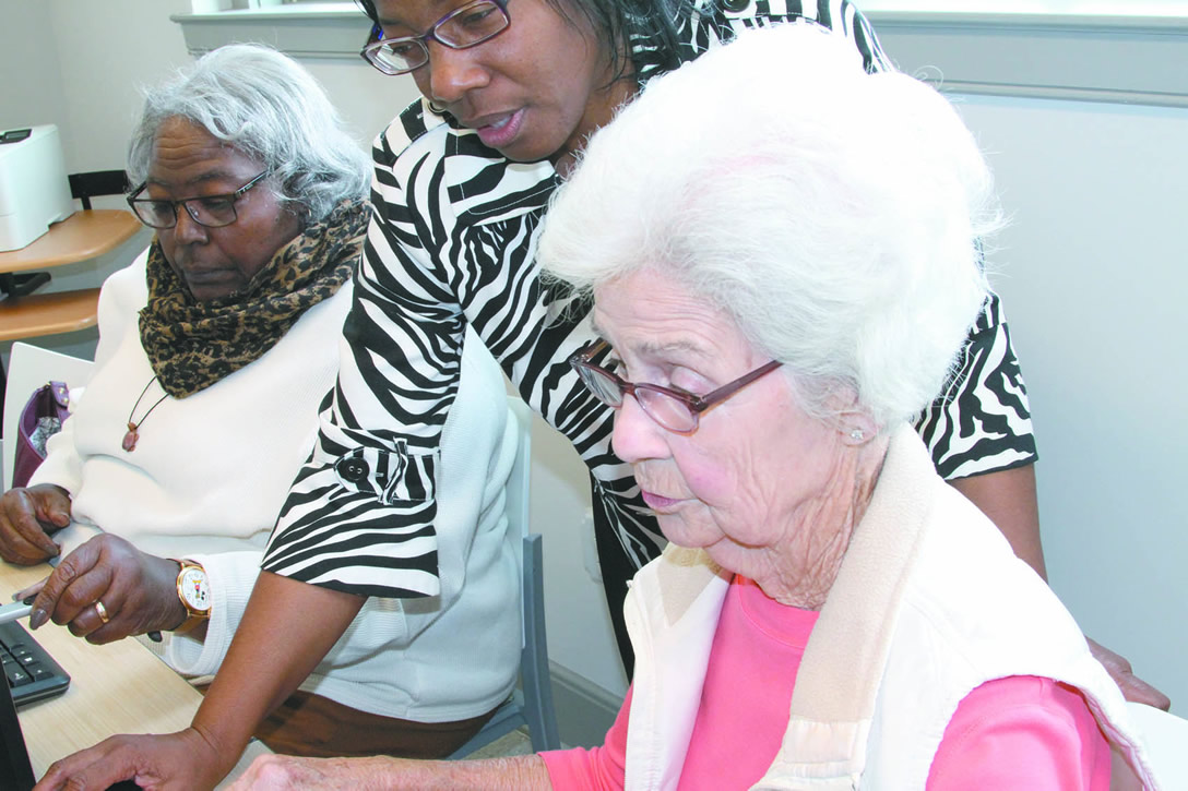 Click to enlarge,  Melody Brown-Peyton, The Daily Record. Instructor Robin Jones helps her student, Minnie Crite.