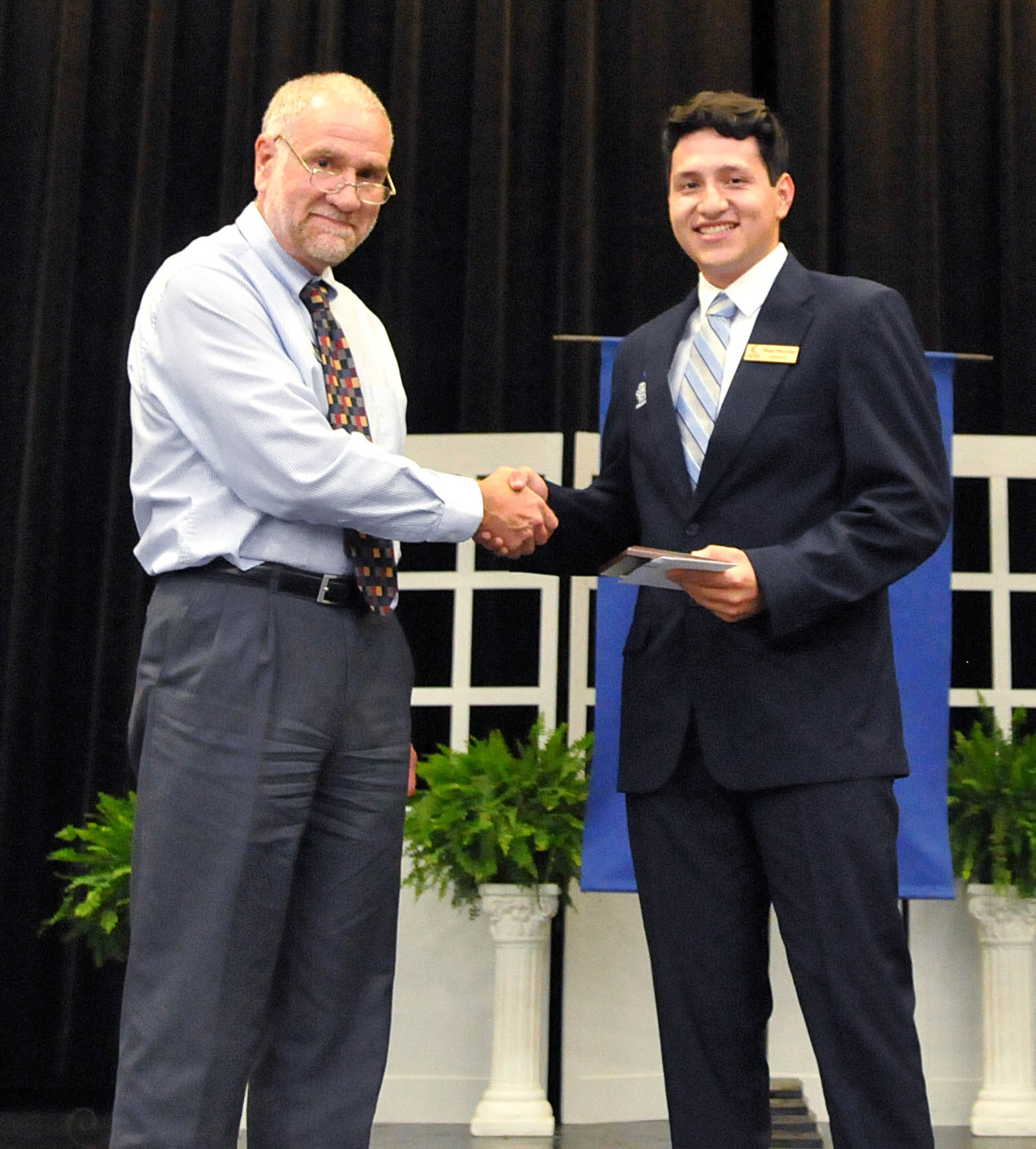 Click to enlarge,  Noel Martinez (right) is recipient of Central Carolina Community College's Cary C. Todd Award for Mathematics Excellence. Presenting the award to Martinez is Fred Fritz, CCCC Department Chair - Math & Science.