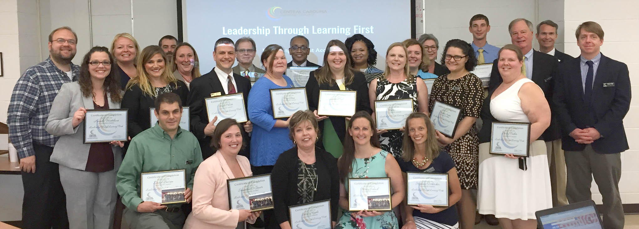 Click to enlarge,  The Central Carolina Community College 2016-2017 Leadership through Learning First Cohort has successfully completed a year-long program, which equips employees with opportunities to enhance their skills, knowledge, and abilities by providing them with resources and networking opportunities to ensure their success. During its commencement, the group shared with members of the President's Council two projects it developed to increase student access from the college's Strategic Plan. Pictured are, left to right: back row, Dr. Brian Merritt (Vice President of Student Learning), Joli McDonald, John Ainsworth, John LaVere, Derrick Wright, Rosalind Cross, Cricket Jones, Jonathan Hockaday, Dr. T. Eston Marchant (President), Ken Hoyle (Vice President of Student Services), and Mark Hall (Chatham Provost); middle row, Amanda Matthews, Amber Thomas, Maryann Aucompaugh, Mike Peluso, Faye Stone, Diana Cagle, Misty Davin, Amy Whitmer, Teradee Hagan, and Becky Finken; front row, David Barron, Samantha O'Connor, Shirley Rijkse, Mary Schmid, and Stephanie Whitaker. Not pictured is Latasha McIver.
