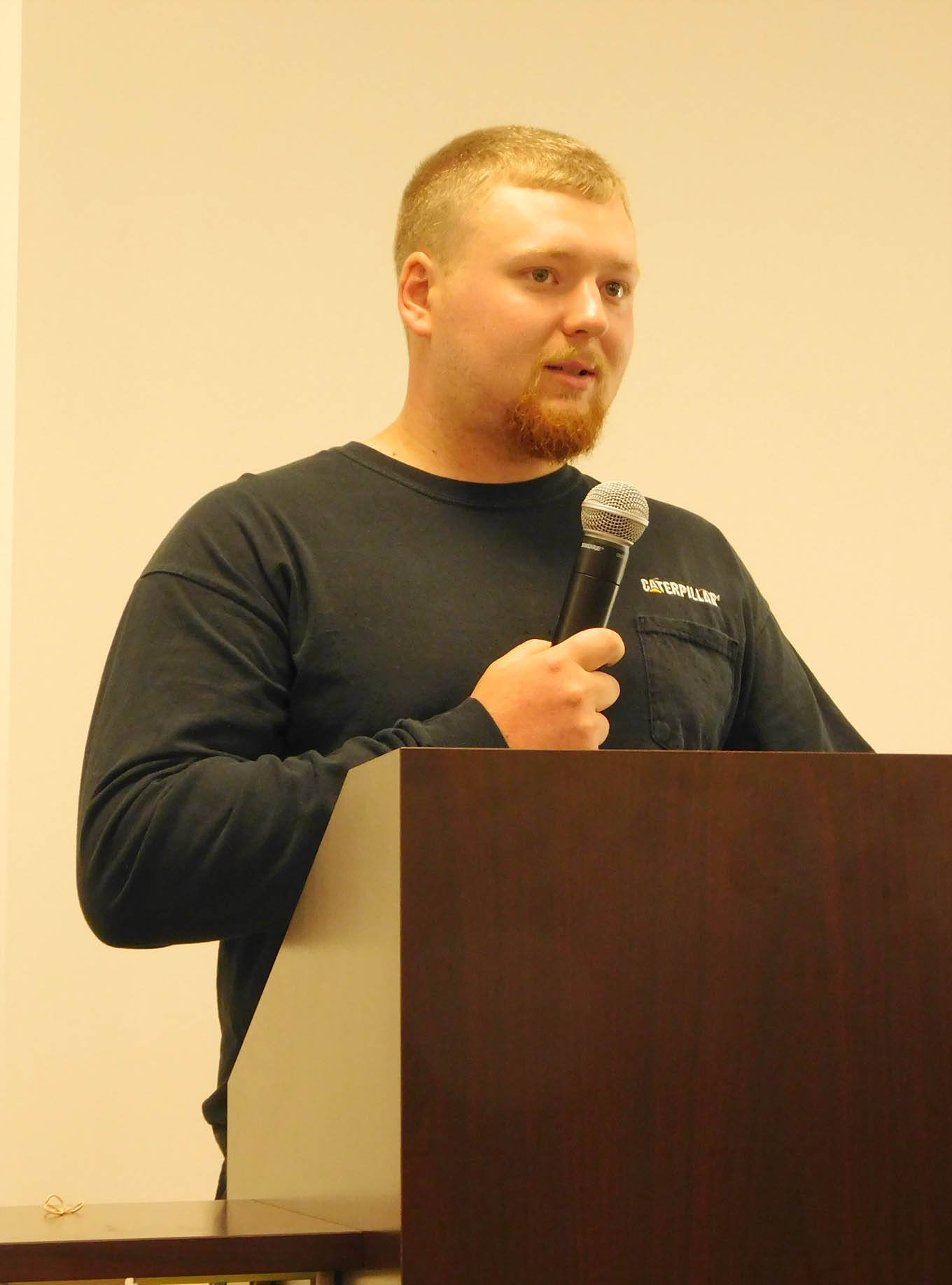 Click to enlarge,  Anthony Woodlief, former Caterpillar student, was a speaker at the Caterpillar Youth Apprentice Program graduation and induction.