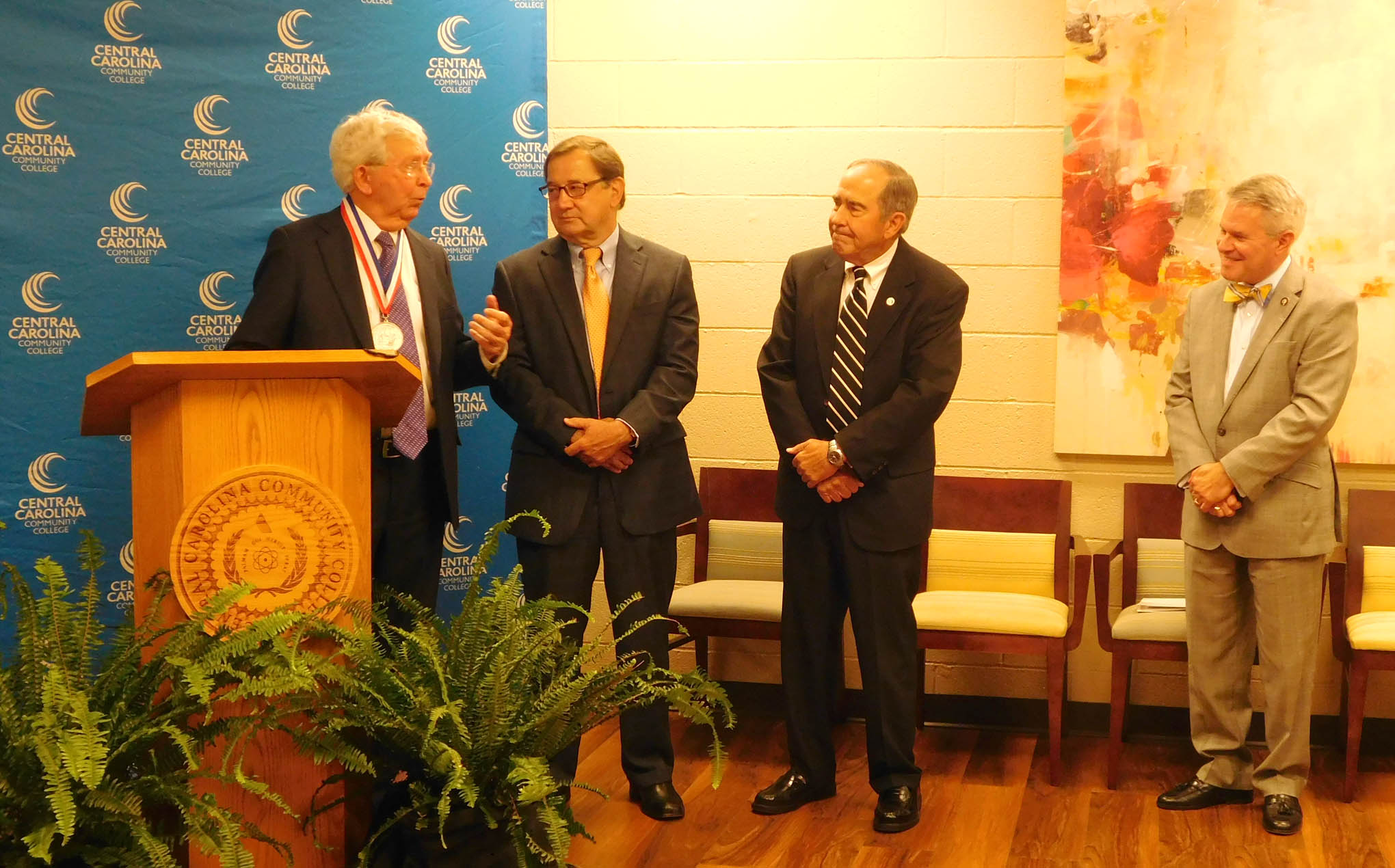 Click to enlarge,  Dr. J.F. Hockaday (far left), the latest recipient of the I.E. Ready Award, the highest honor bestowed by the State Board of Community Colleges, visits with (left to right) Dr. Donny Hunter, President and CEO of the N.C. Association of Community College Trustees; Dr. Ronald Lingle, President Emeritus of Coastal Carolina Community College; and Dr. James C. Williamson, President of the North Carolina Community College System.