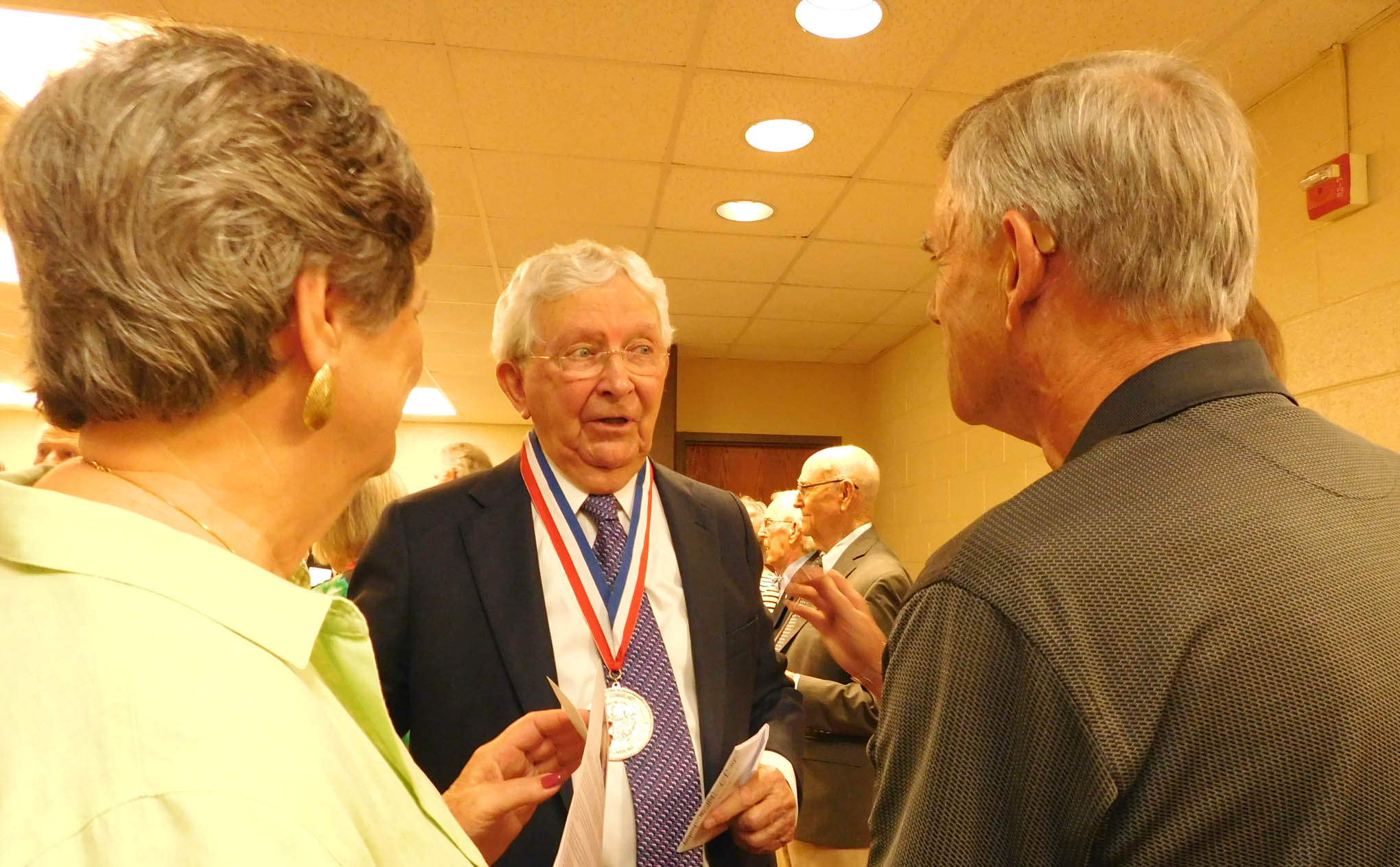 Click to enlarge,  Dr. J.F. Hockaday (left), president of Central Carolina Community College from 1969 to 1983, and recipient of the I.E. Ready Award, visits with award reception attendees.